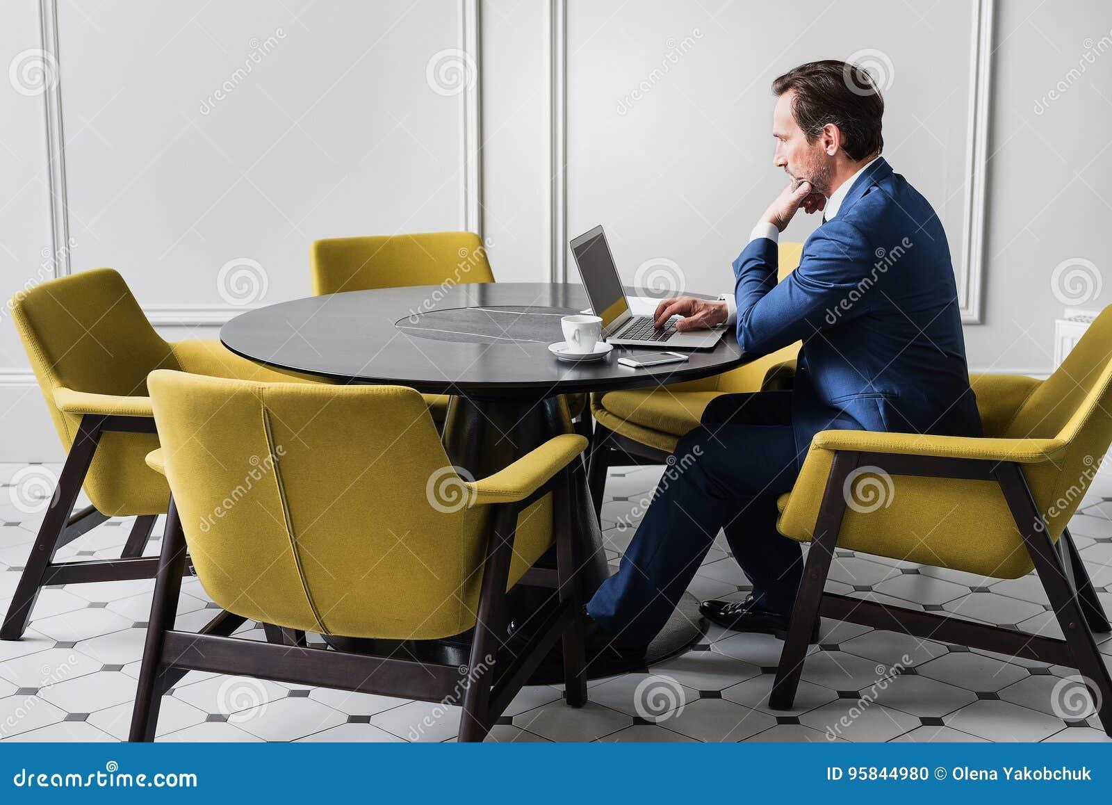 Serious man wording on modern computer
