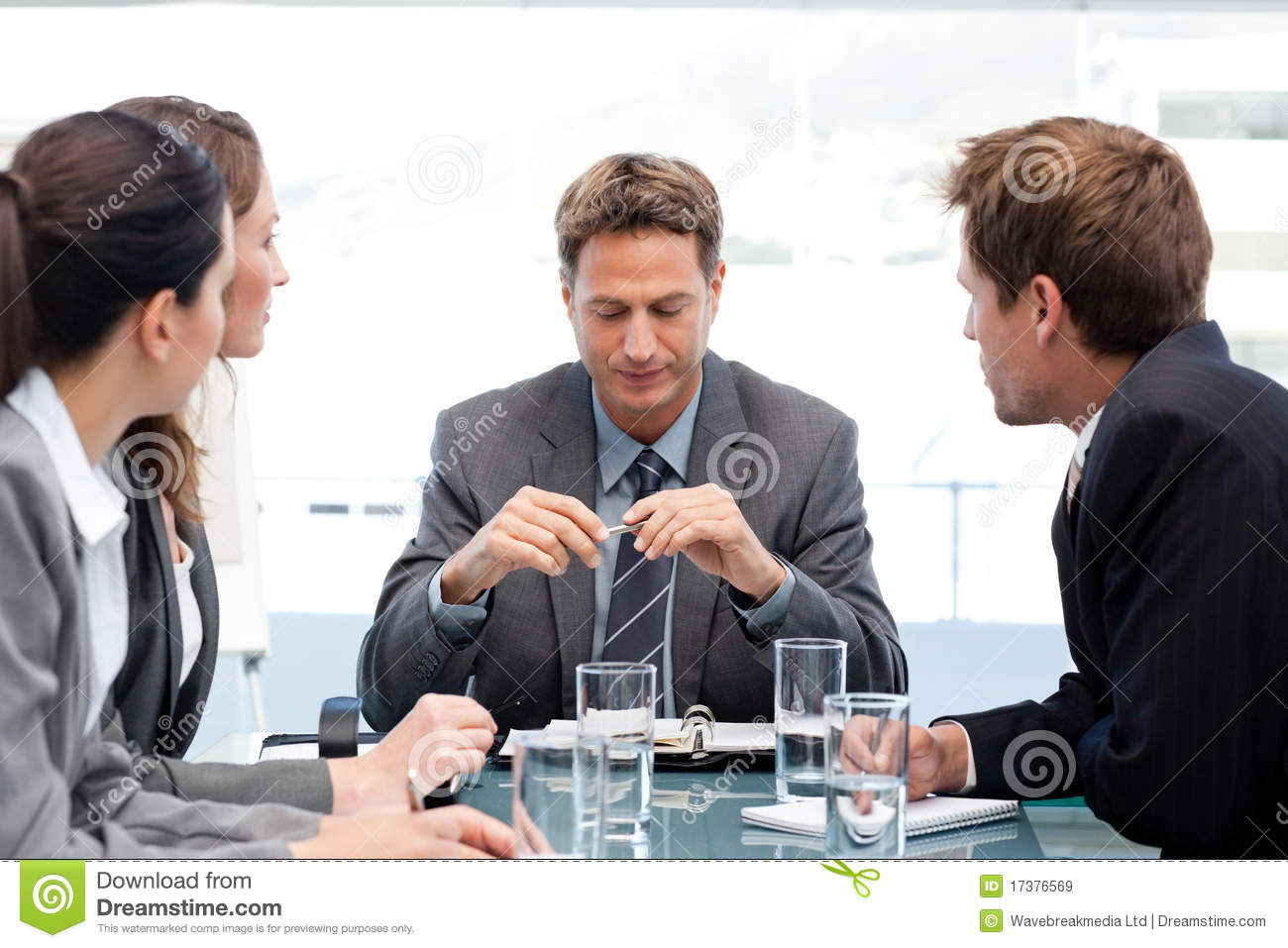 Serious manager with his team during a meeting