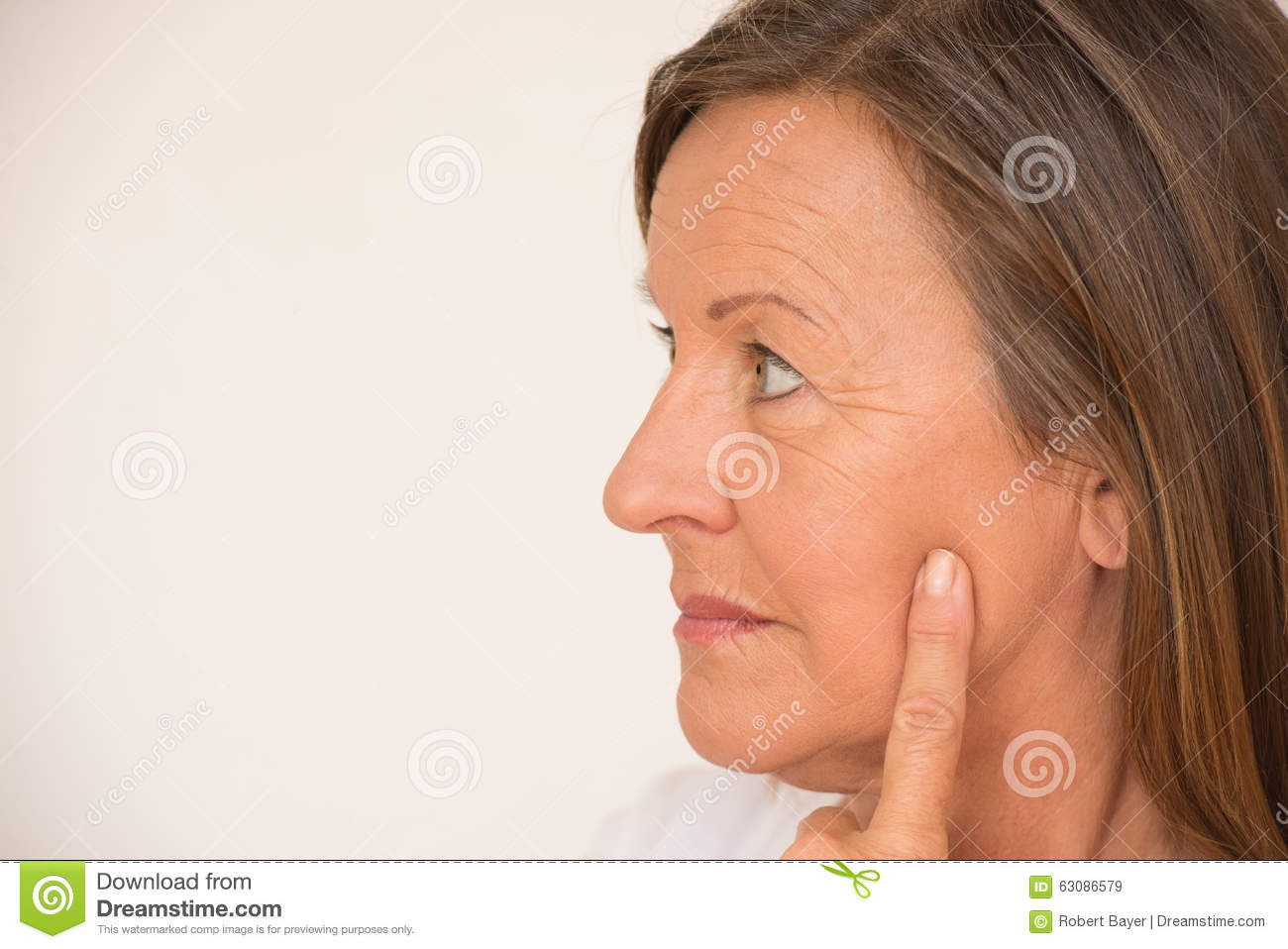 Serious Mature Woman Thinking Stock Photo - Image: 63086579