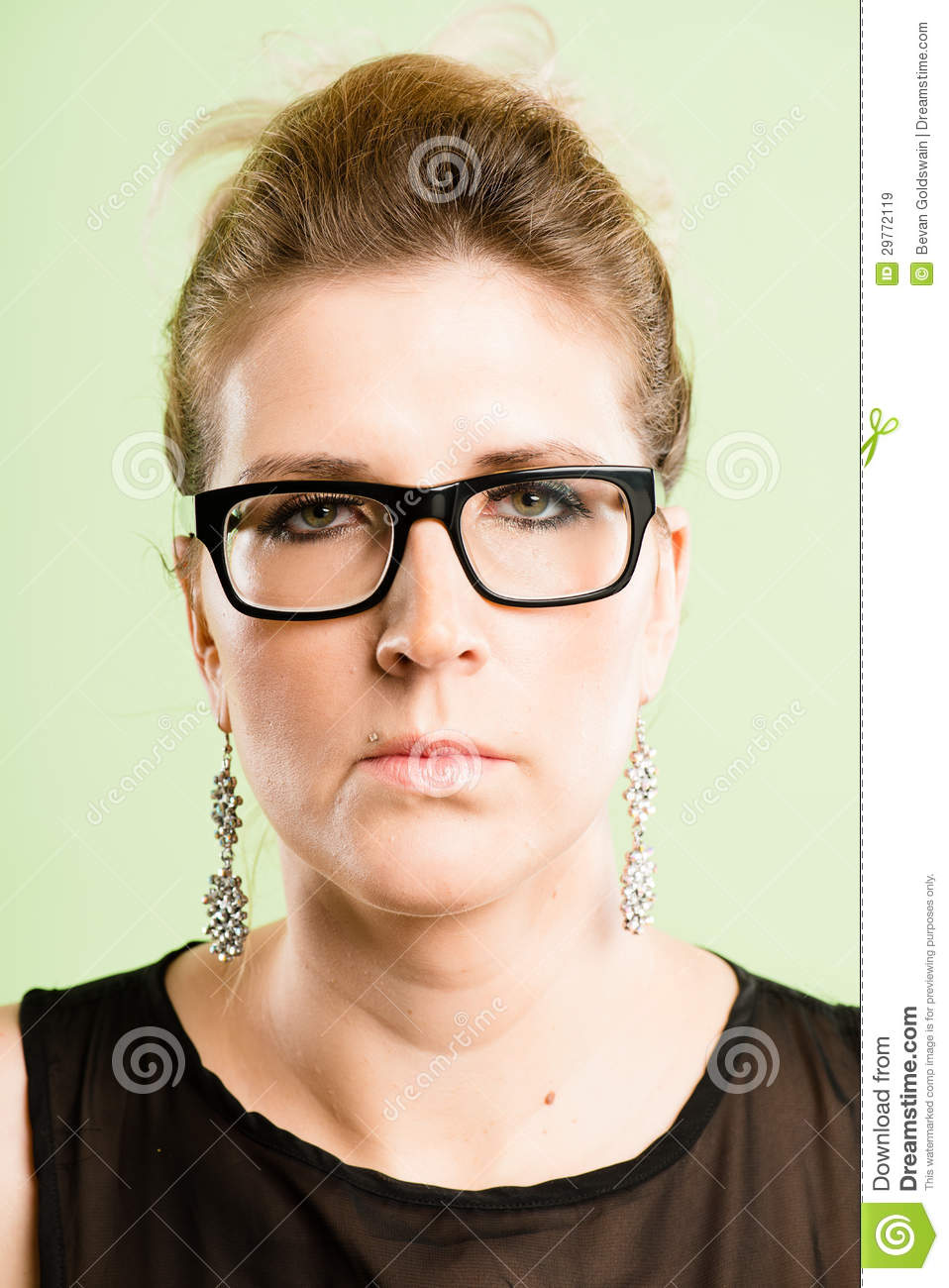 Serious woman portrait real people high definition green background