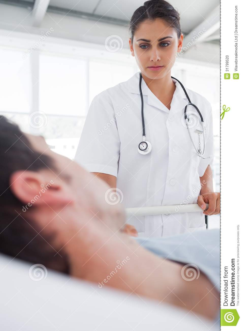 Serious Nurse Taking Care Of A Patient Stock Photo - Image ...