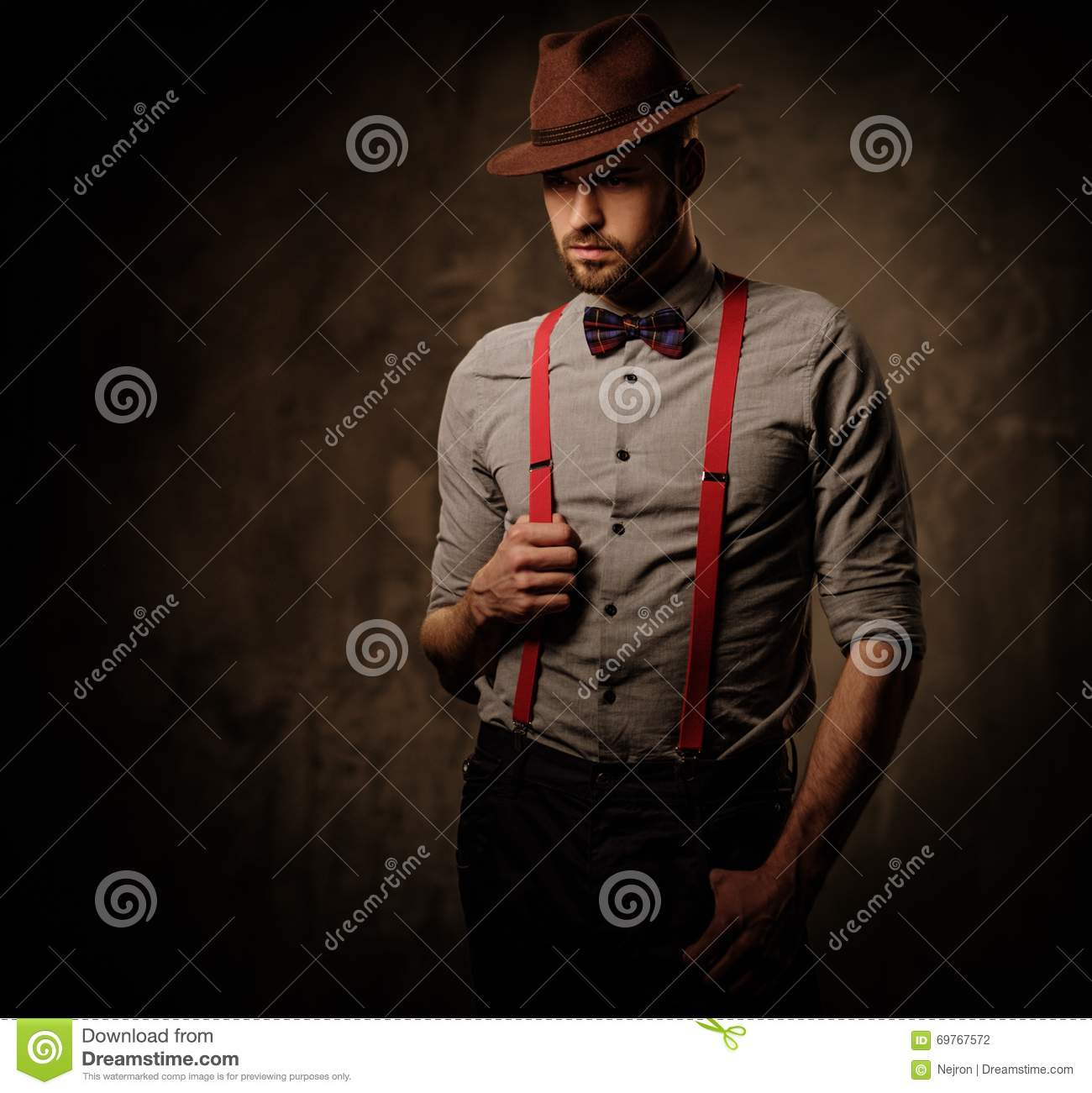 serious old fashioned man with hat wearing suspenders and. Black Bedroom Furniture Sets. Home Design Ideas