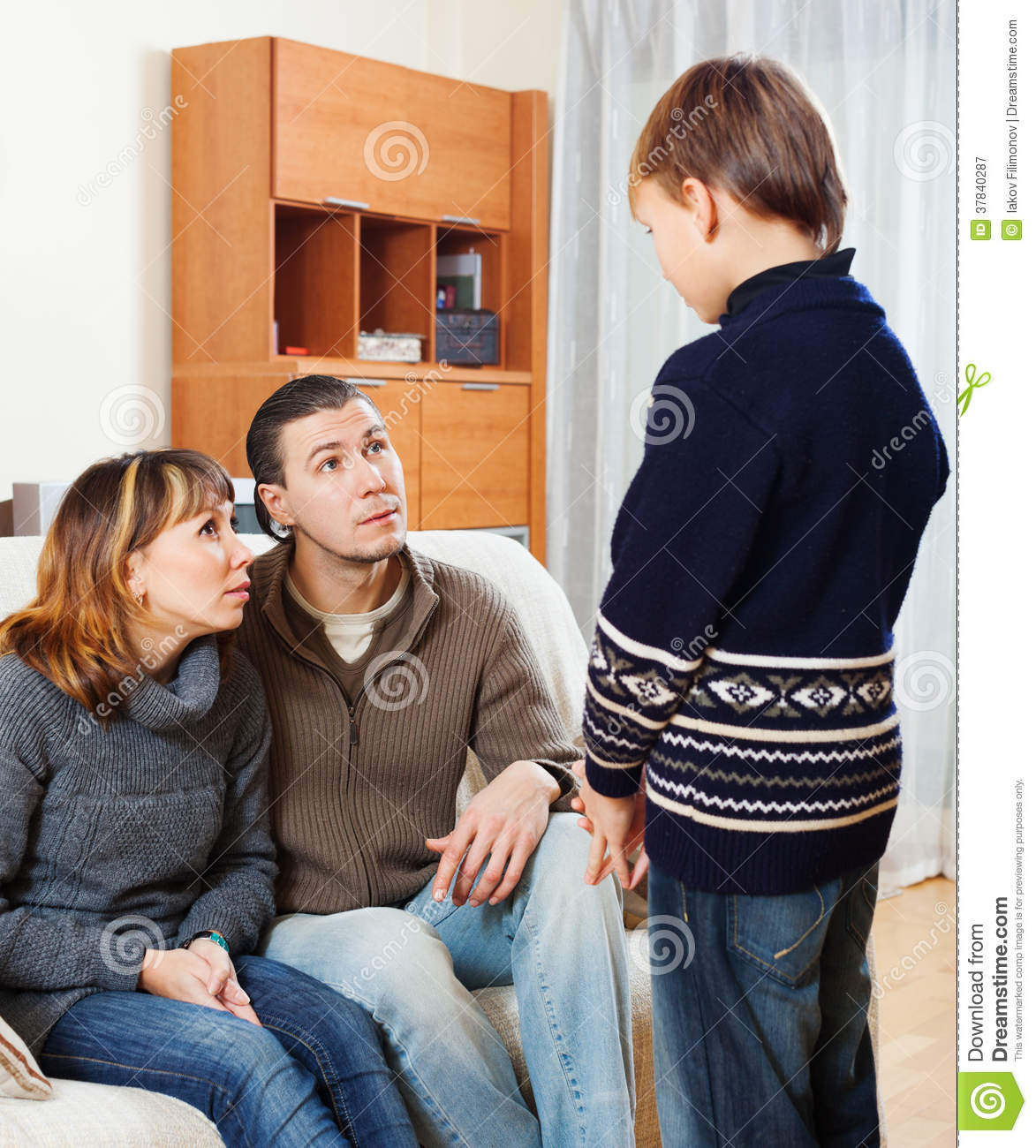 Serious Parents Scolding Son Stock Image - Image of person ...