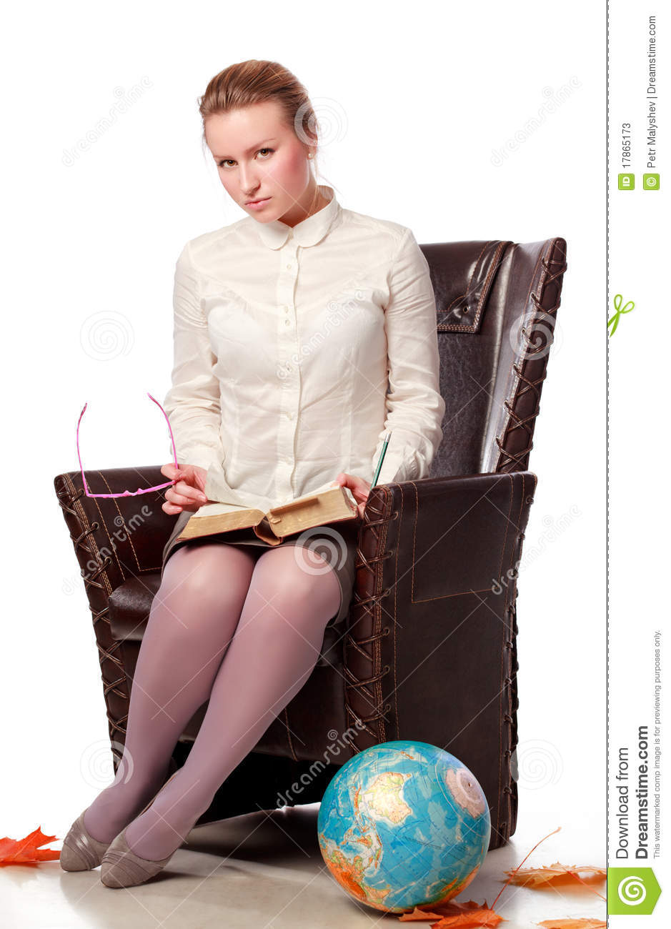 Serious teacher sitting in armchair stock photos image for Sitting in armchair