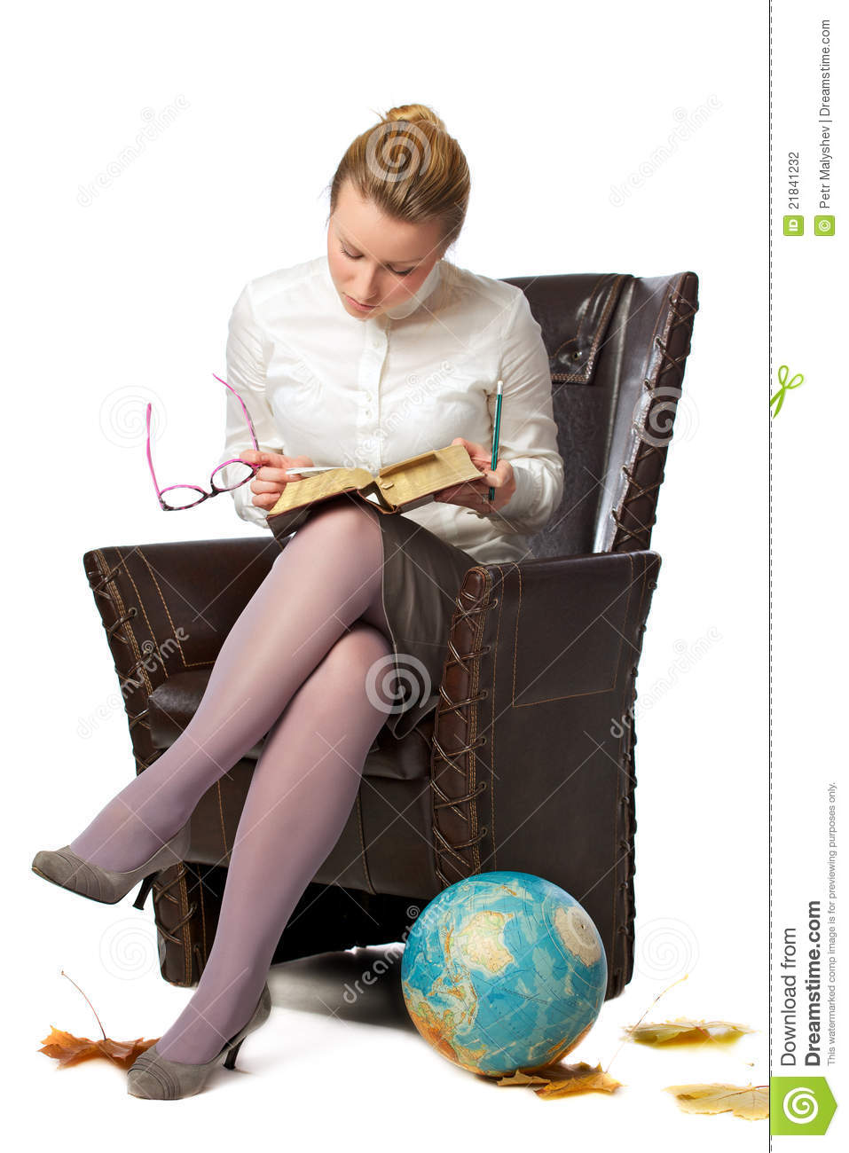 Serious teacher sitting in armchair stock photography for Sitting in armchair