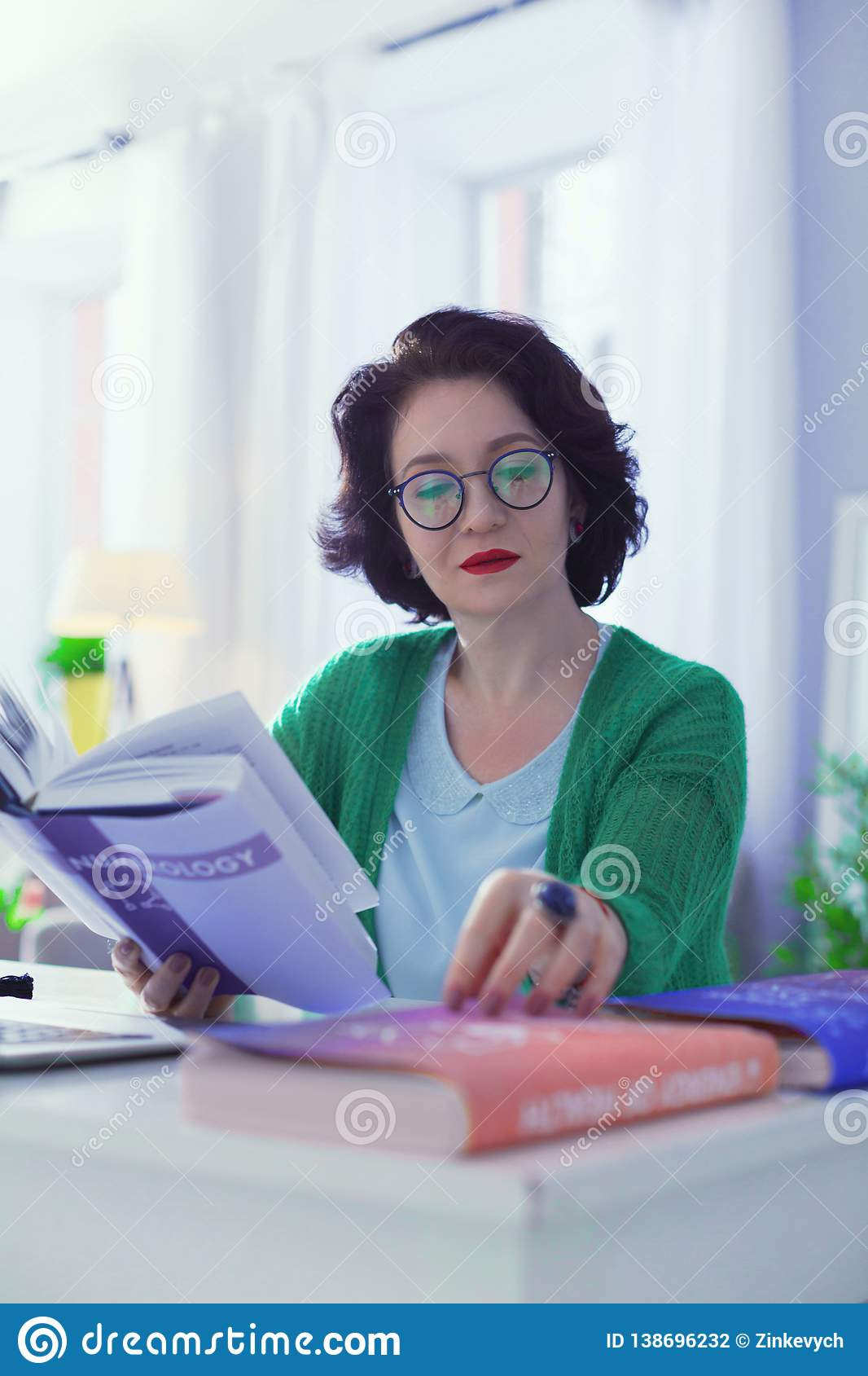 Serious Thoughtful Woman Being Interested In Numerology