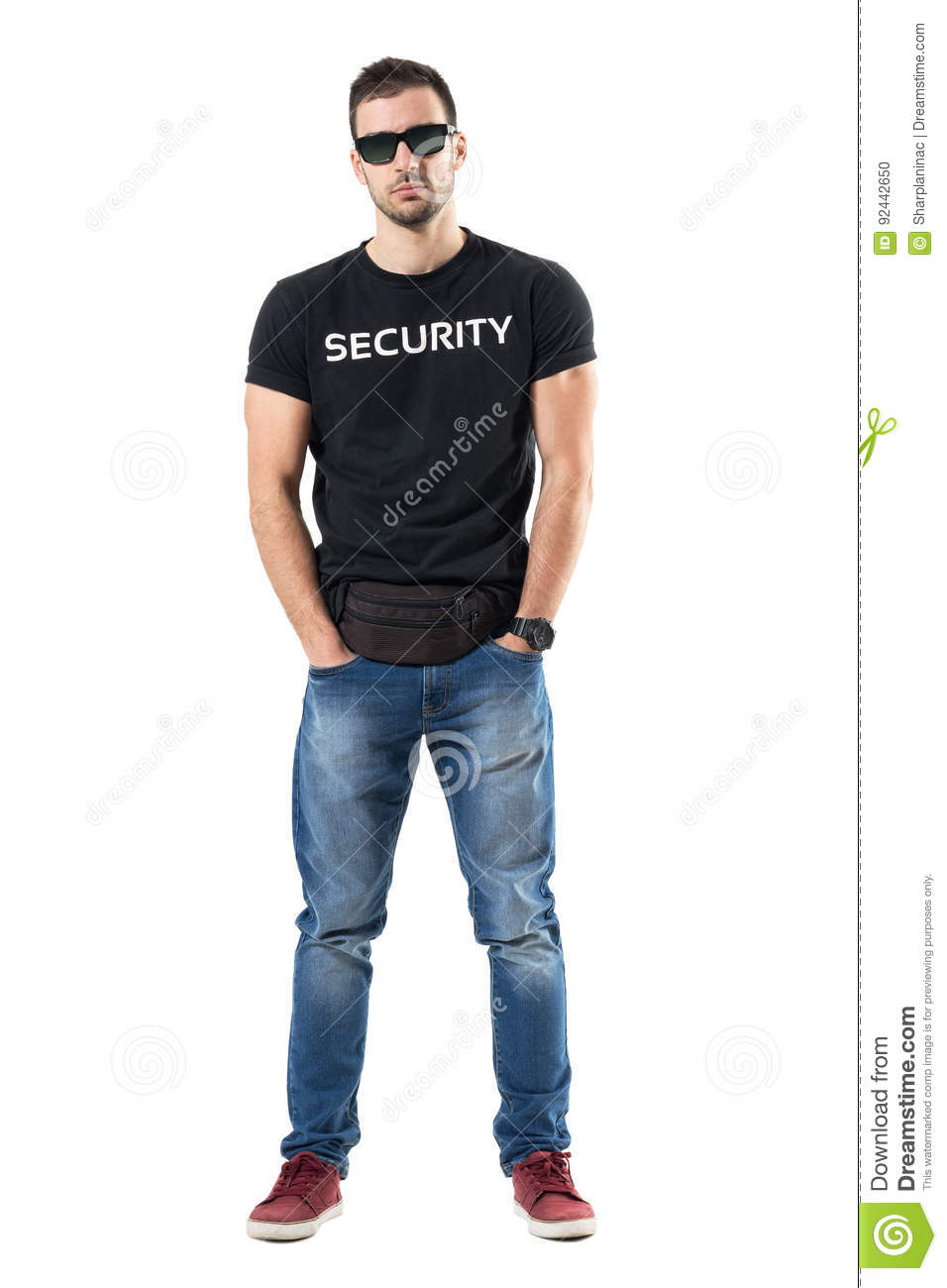 Serious Undercover Cop With Hands In Pockets Wearing Waist Bag