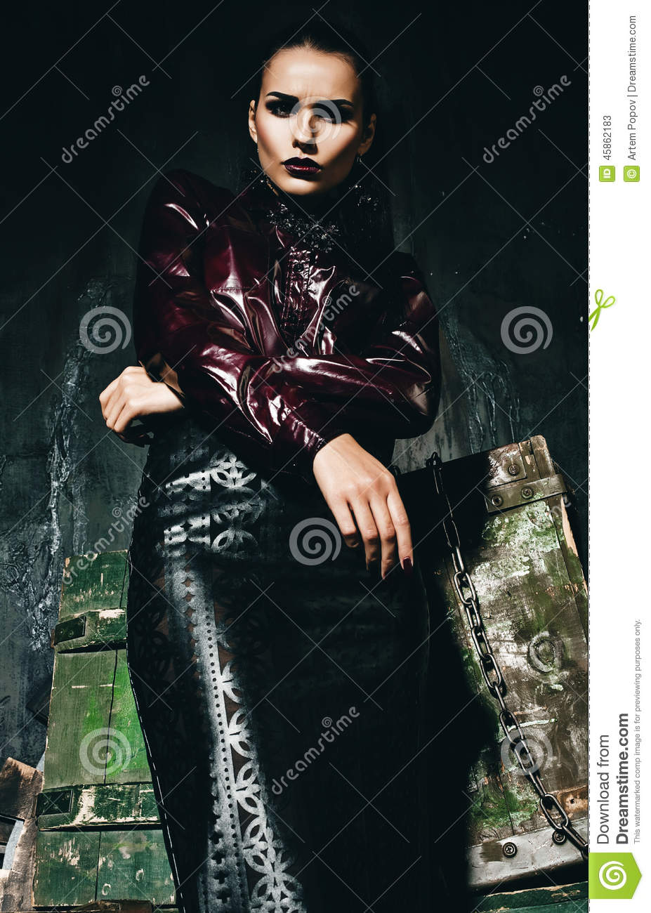 Serious Woman In Claret Shirt And Black Leather Skirt
