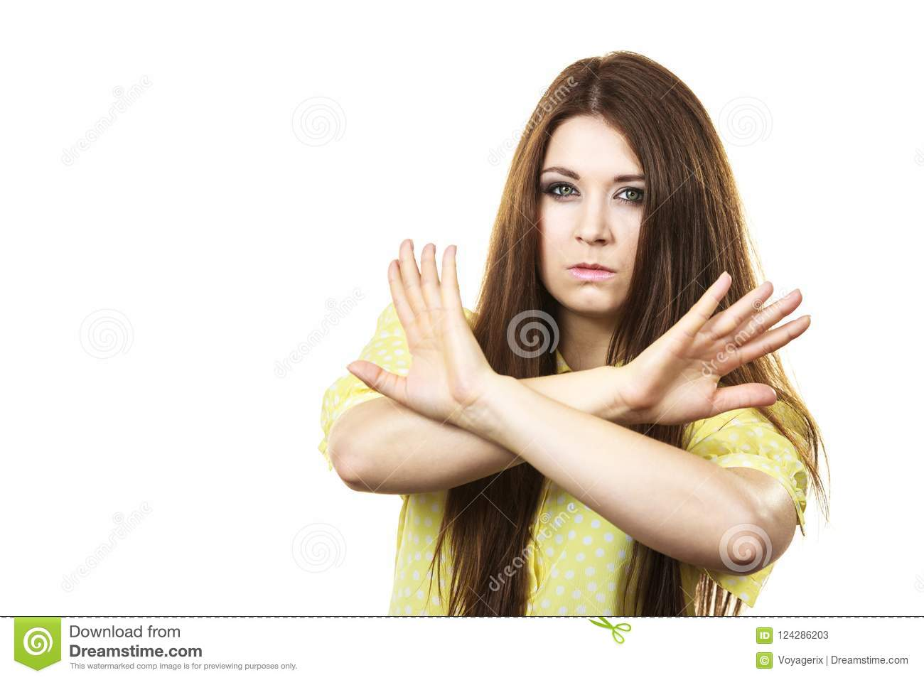Assertive woman showing stop gesture