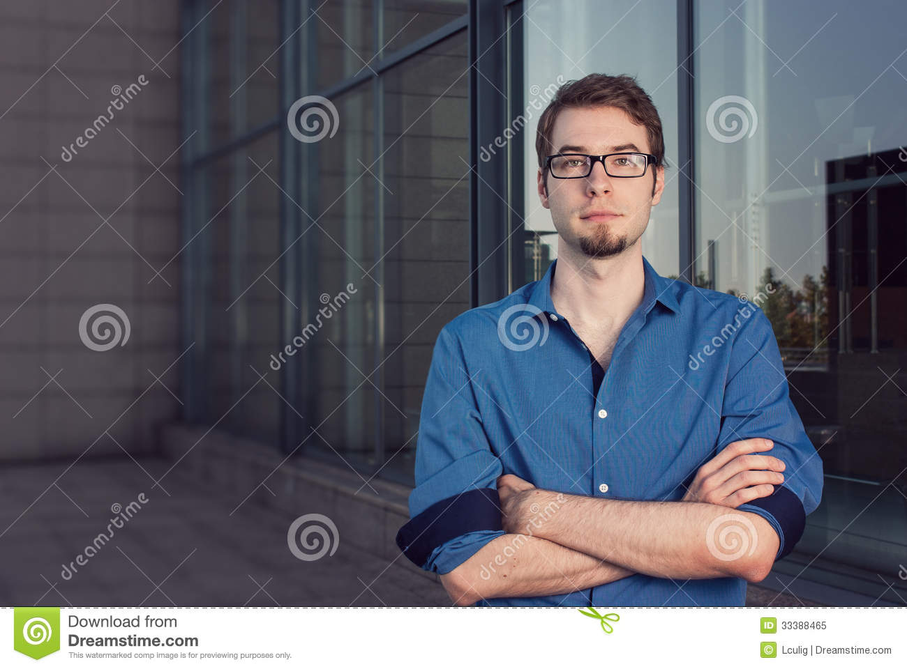 Serious Young Businessman With Arms Crossed Stock Image