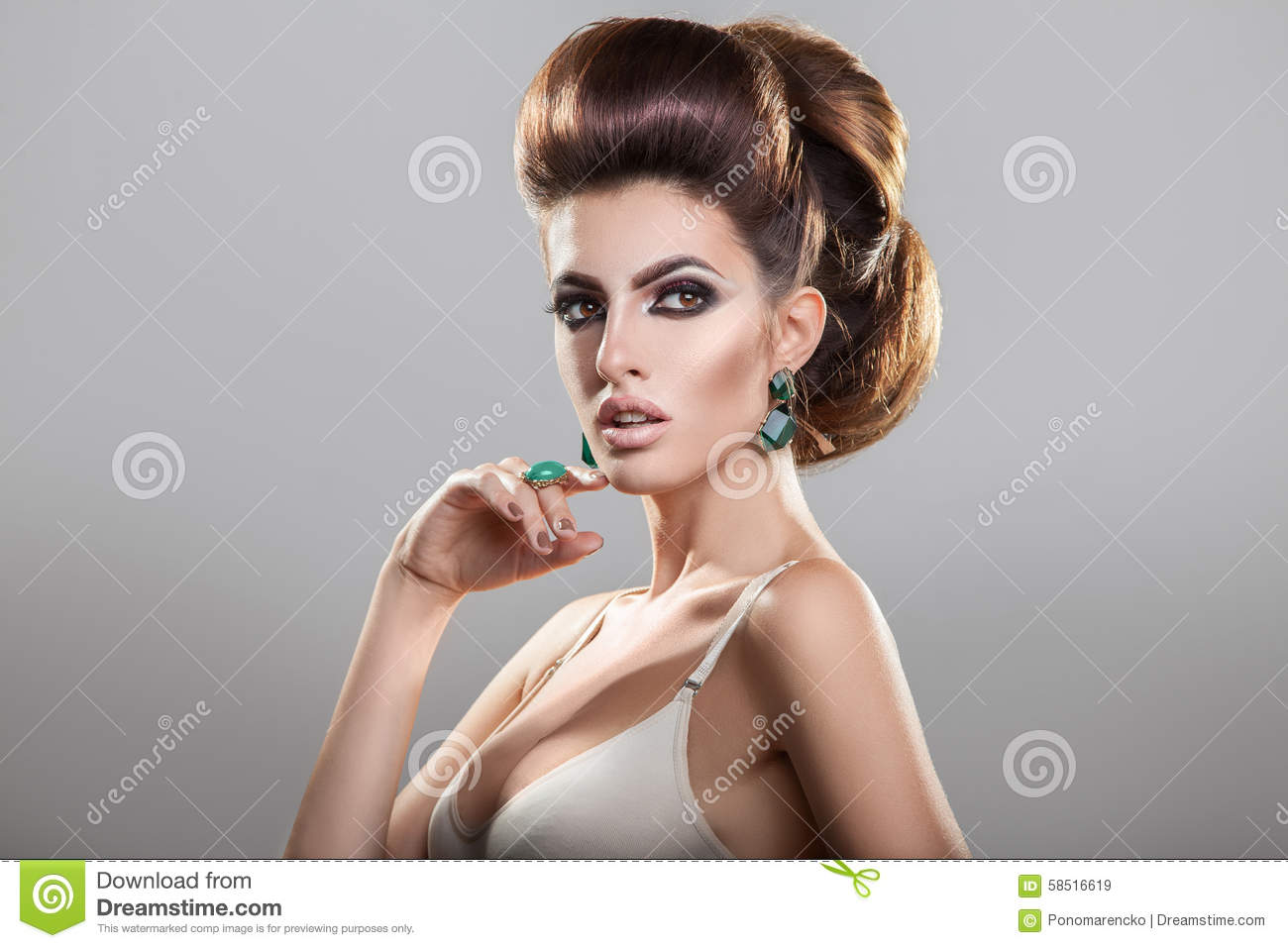 Serious young girl with creative hairstyle looking away