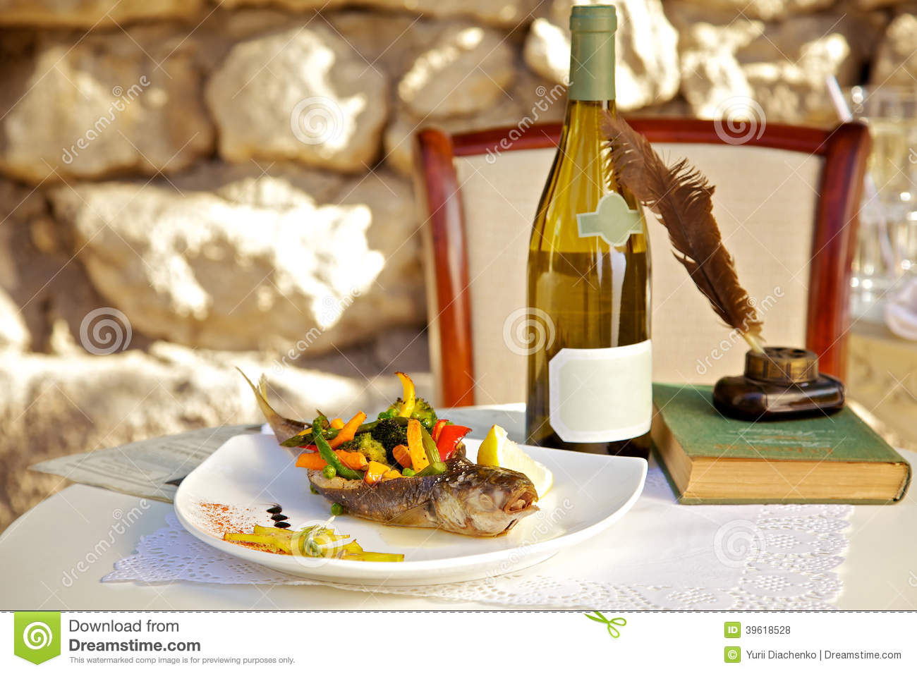 Served table in a restaurant for Fish in a bottle menu