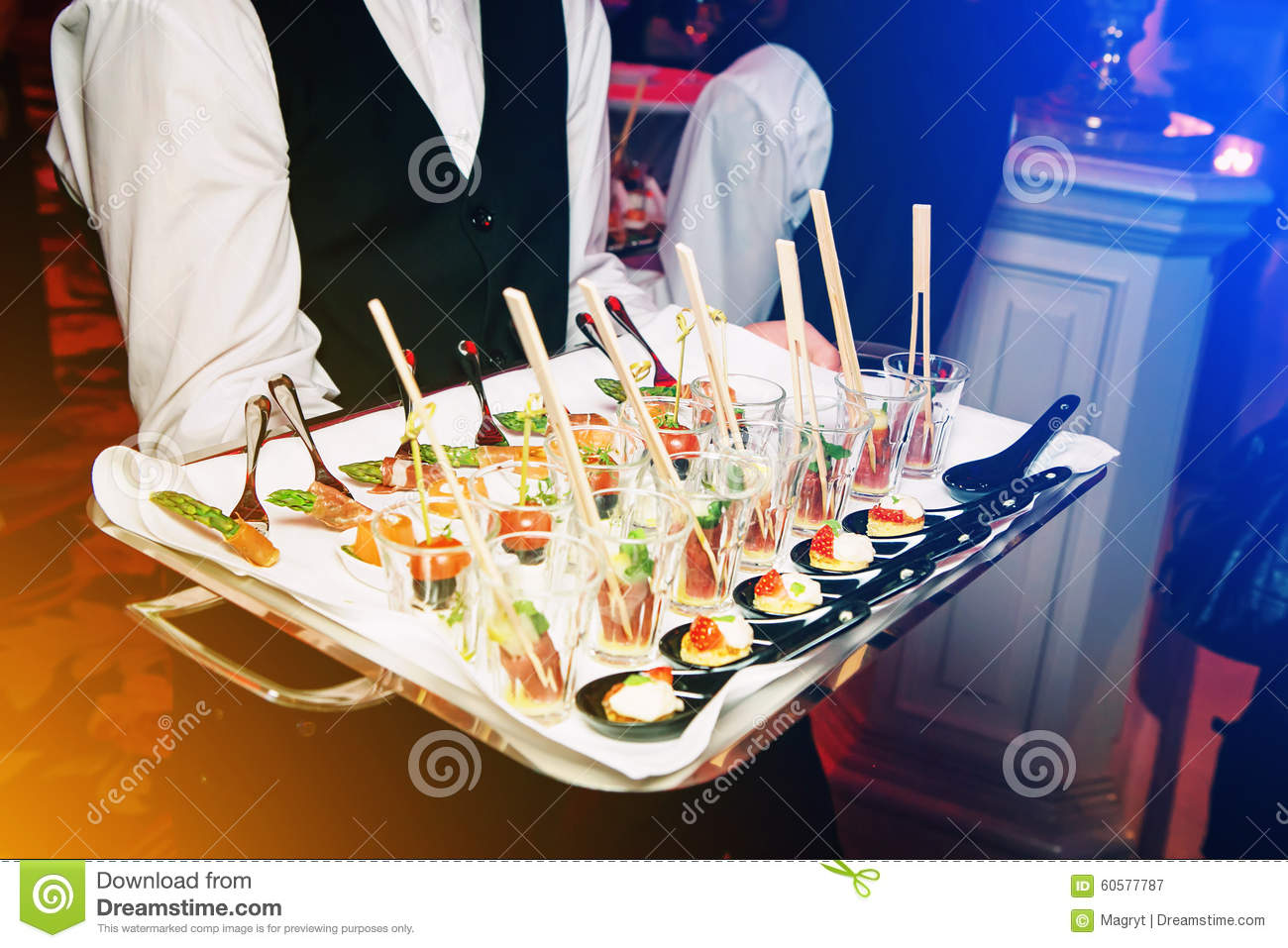 Server holding a tray of appetizers at banquet
