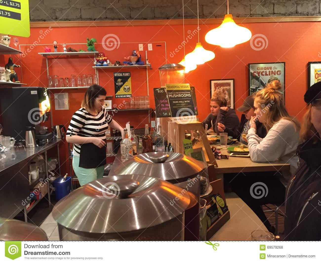 Server Waits On Counter Customers At Laughing Planet Restaurant In