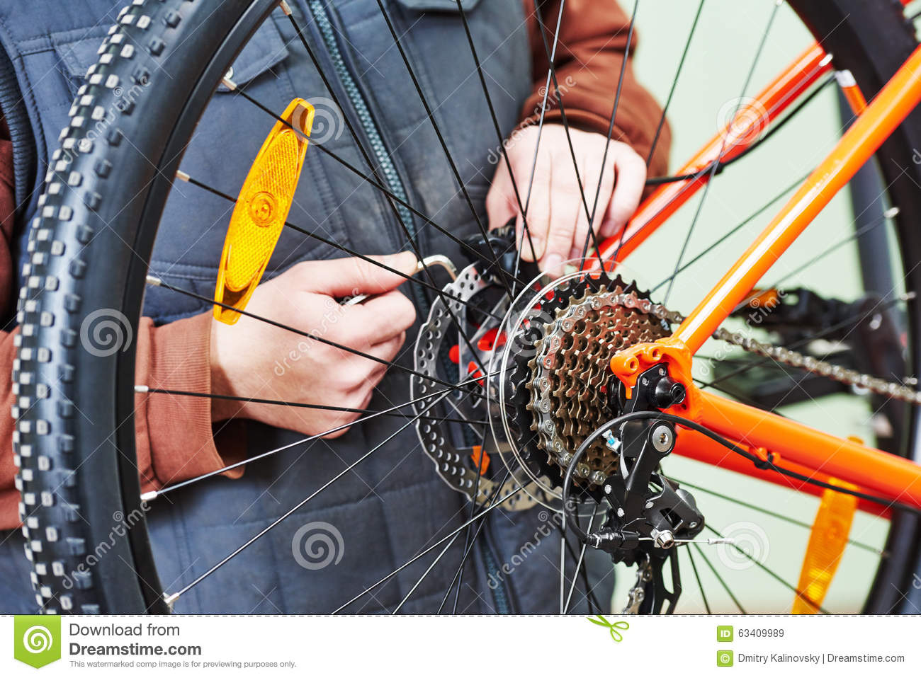 serviceman installing assembling or adjusting bicycle gear on wh