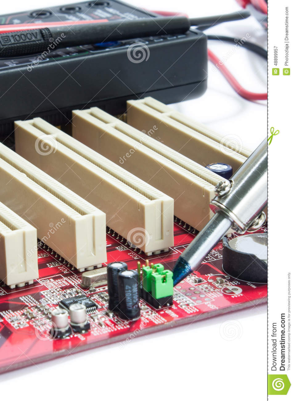 servicer soldered circuit board with a soldering iron stock photo image 48899957. Black Bedroom Furniture Sets. Home Design Ideas