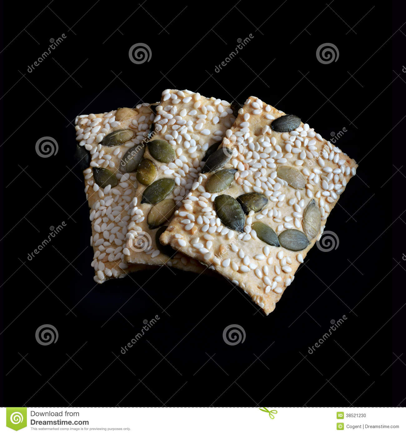Sesame And Pumpkin Seed Flatbreads in natural light against black ...