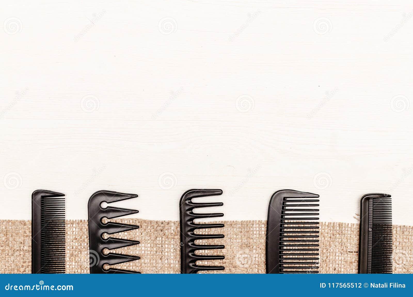 Set of black plastic hair comb.