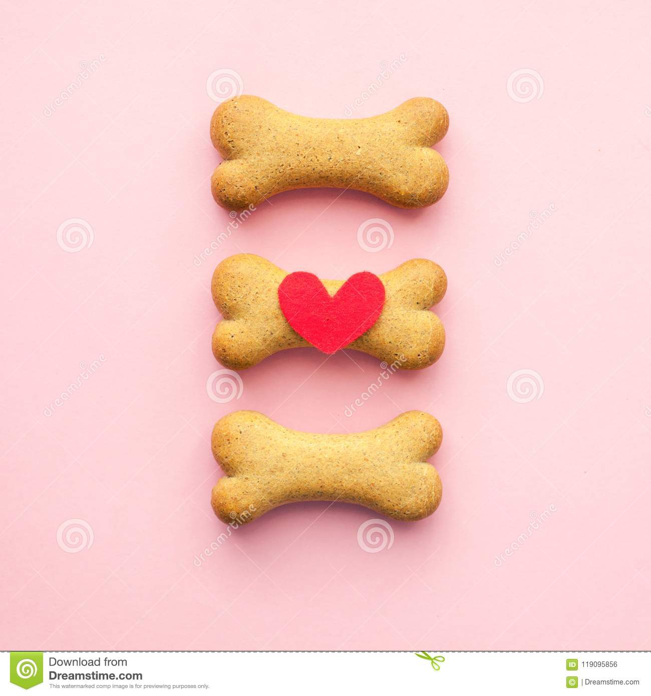 Set of bone-shaped biscuits for dog on pink background, concept pet care.