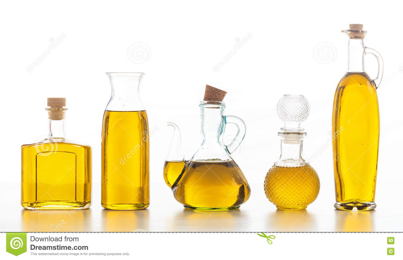 Set Of Bottles With Olive Oil On White Background Stock