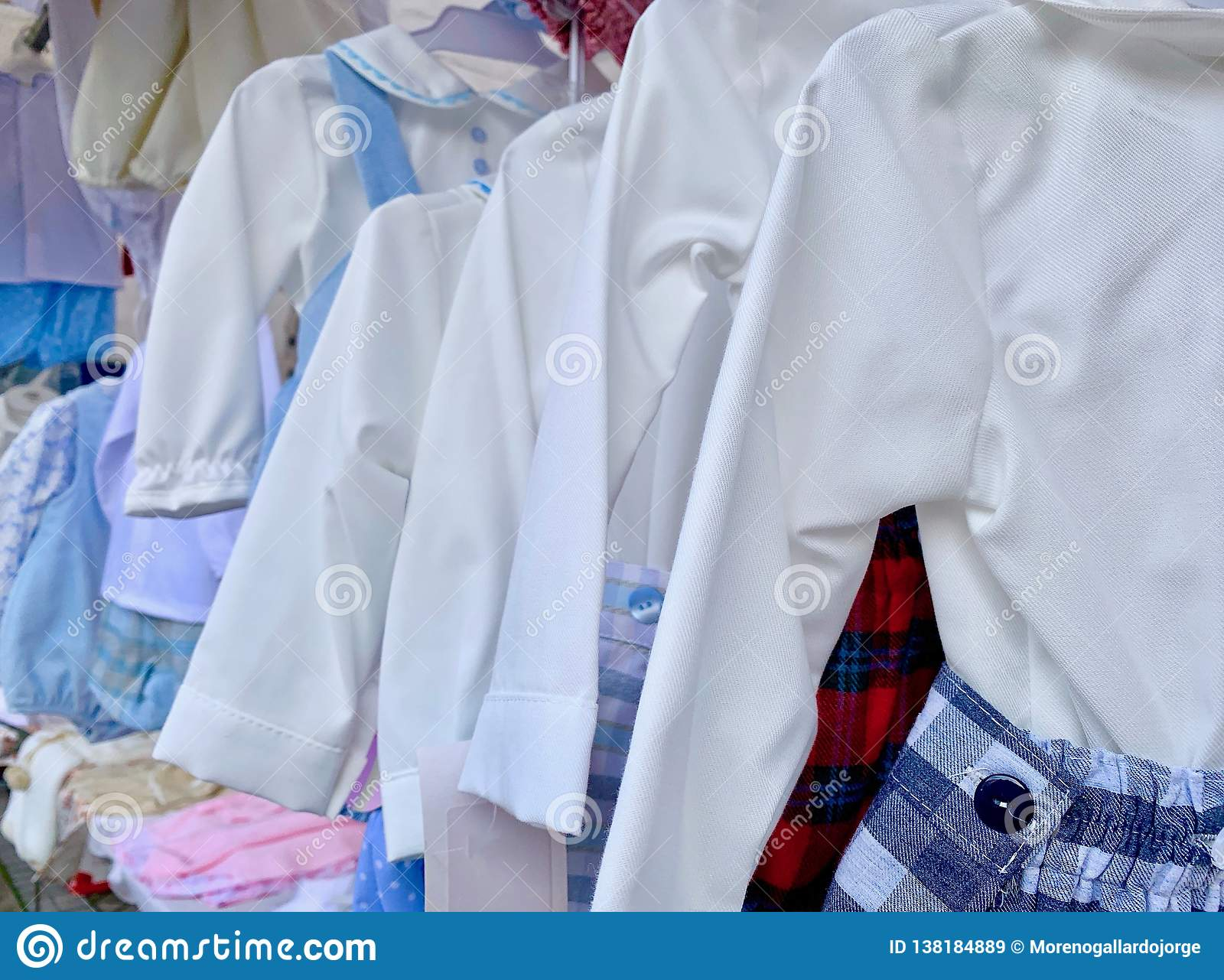 Set of children`s clothes in different colors