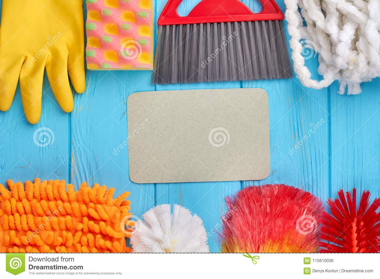 Set of cleaning supplies on wooden table.