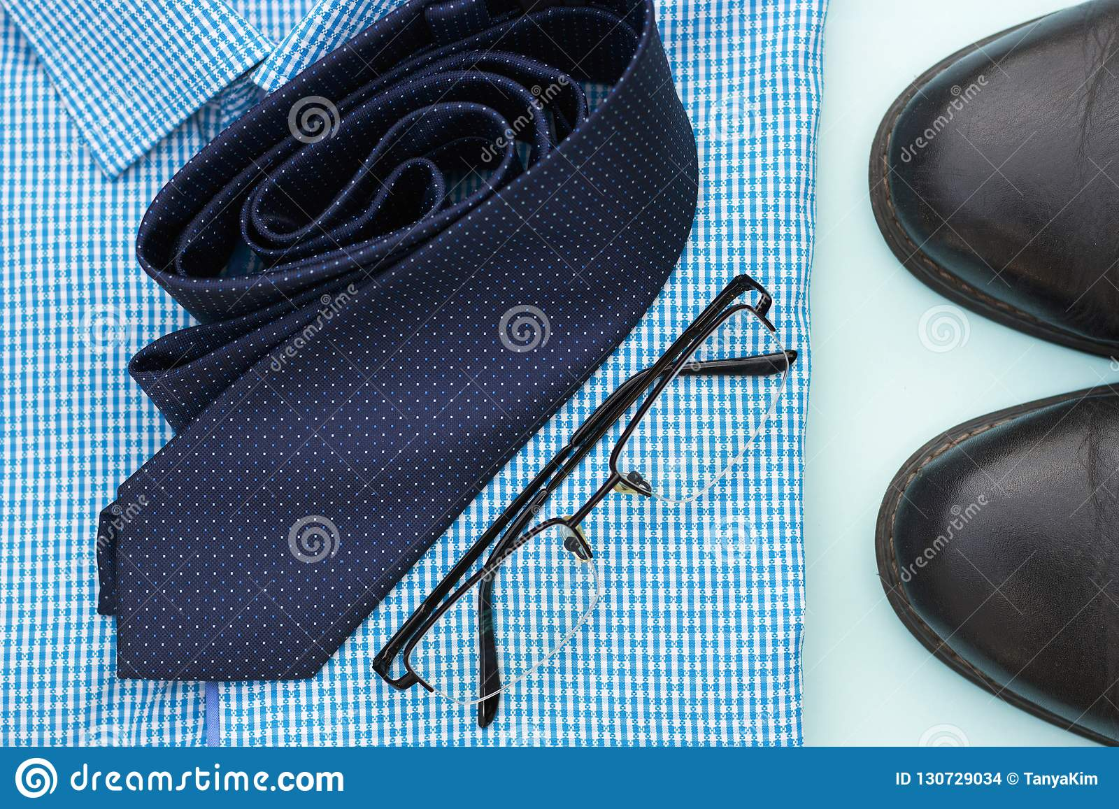 61c743f87255c Set of clothes and accessories for man on blue background, business or  office concept.