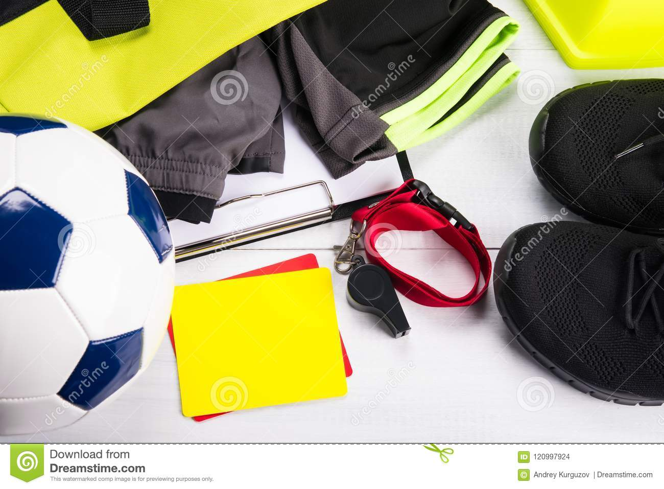 Set of clothes and accessories for the sportsman of the football player on a light background
