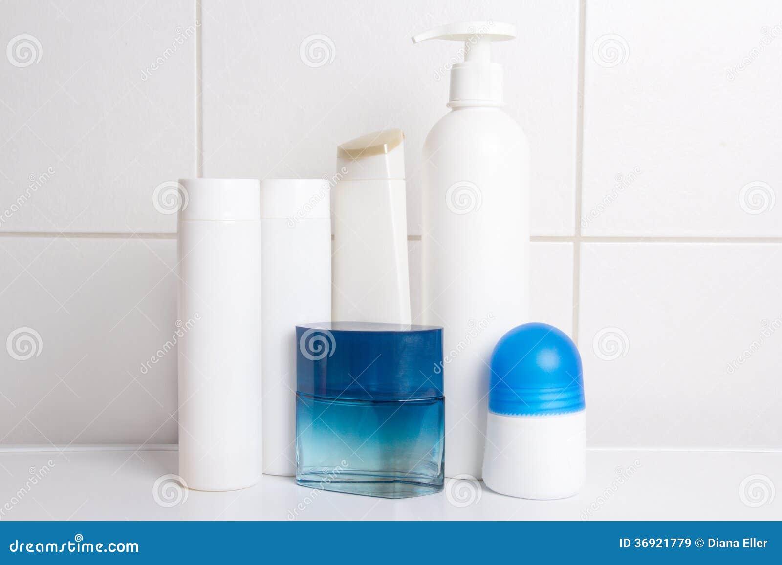 Set of cosmetic bottles over white tiled wall royalty free for Bathroom bottles
