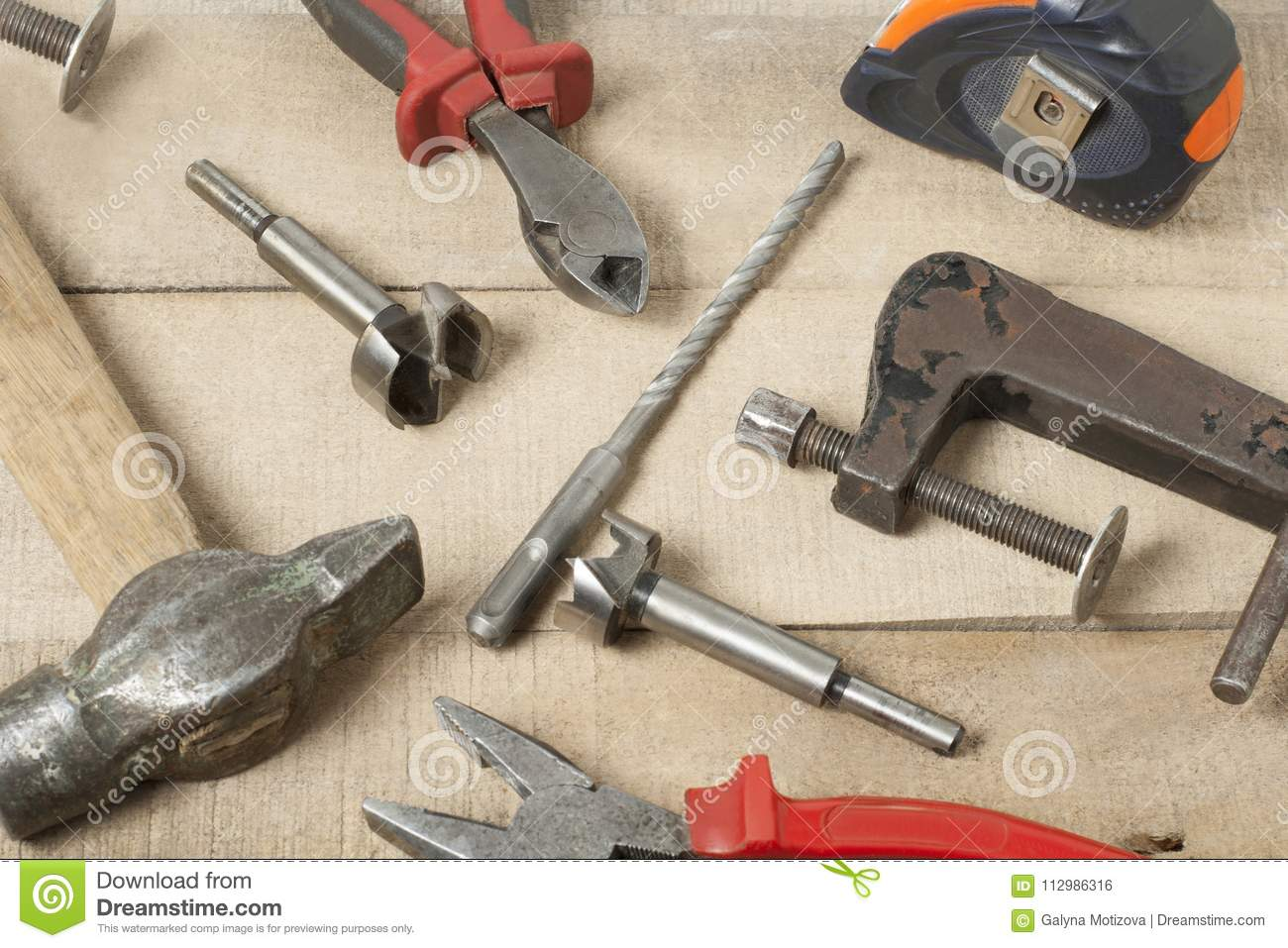 Set of different construction tools on wooden background.Construction concept.