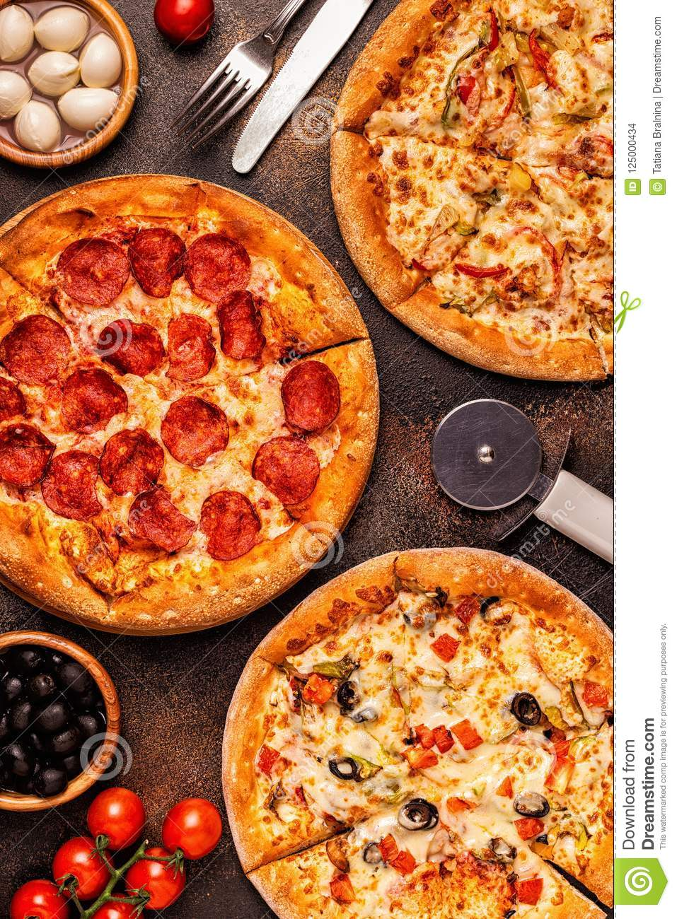 Set of different pizzas - pepperoni, vegetarian, chicken with vegetables