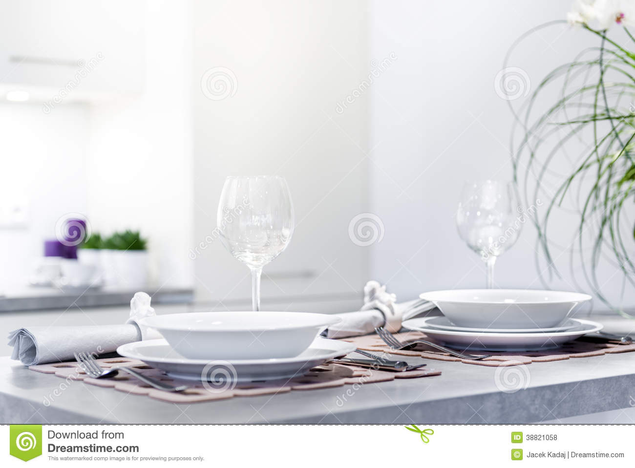 Set Of Dinner Plates In Modern Kitchen Stock Photo