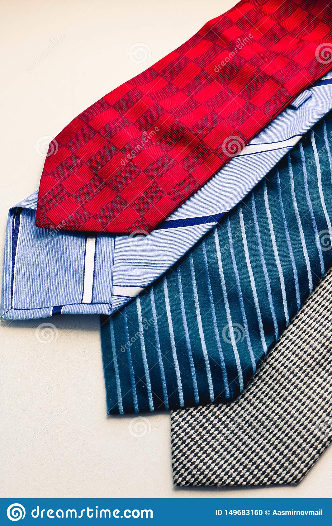 Set of fashion multicolored man`s ties. Red blue gray and striped ties on the white background