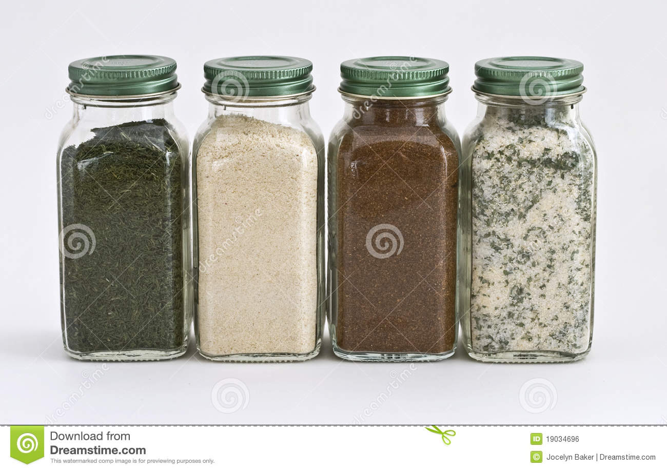 Set Of Four Spices In Glass Jars Stock Photo - Image of
