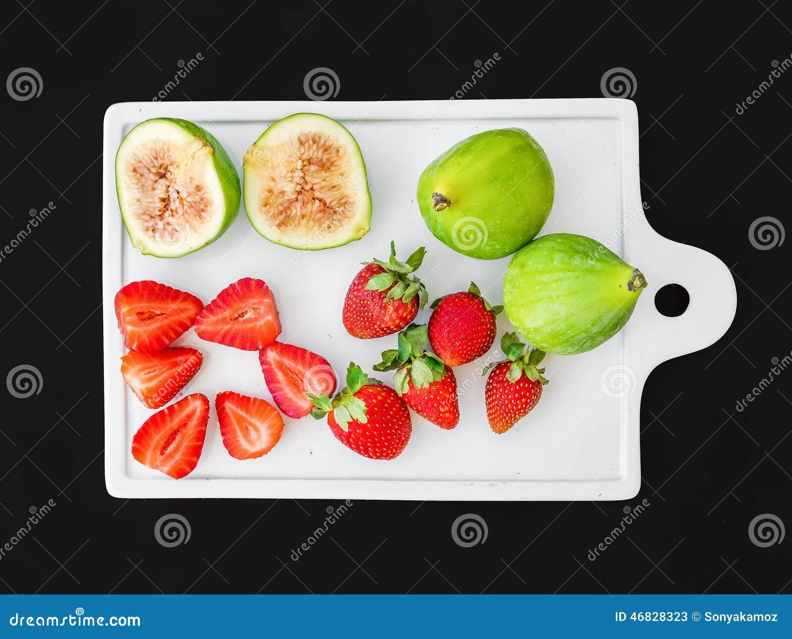 a set of fresh fruit on a white ceramic cutting board stock photo, Kitchen design