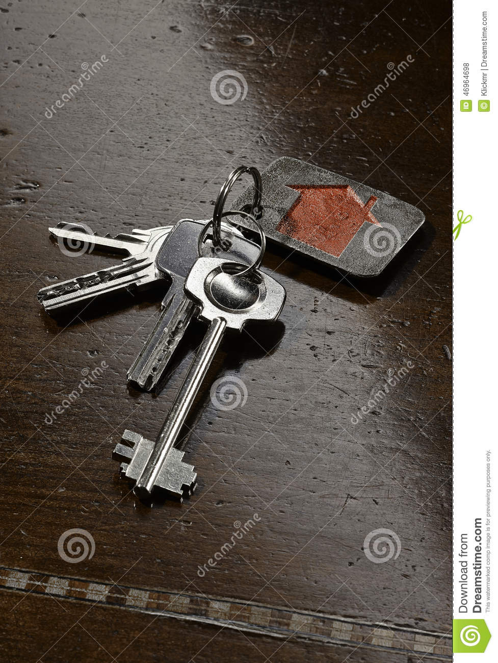 Set Of House Keys On Brown Wooden Table Stock Photo ...