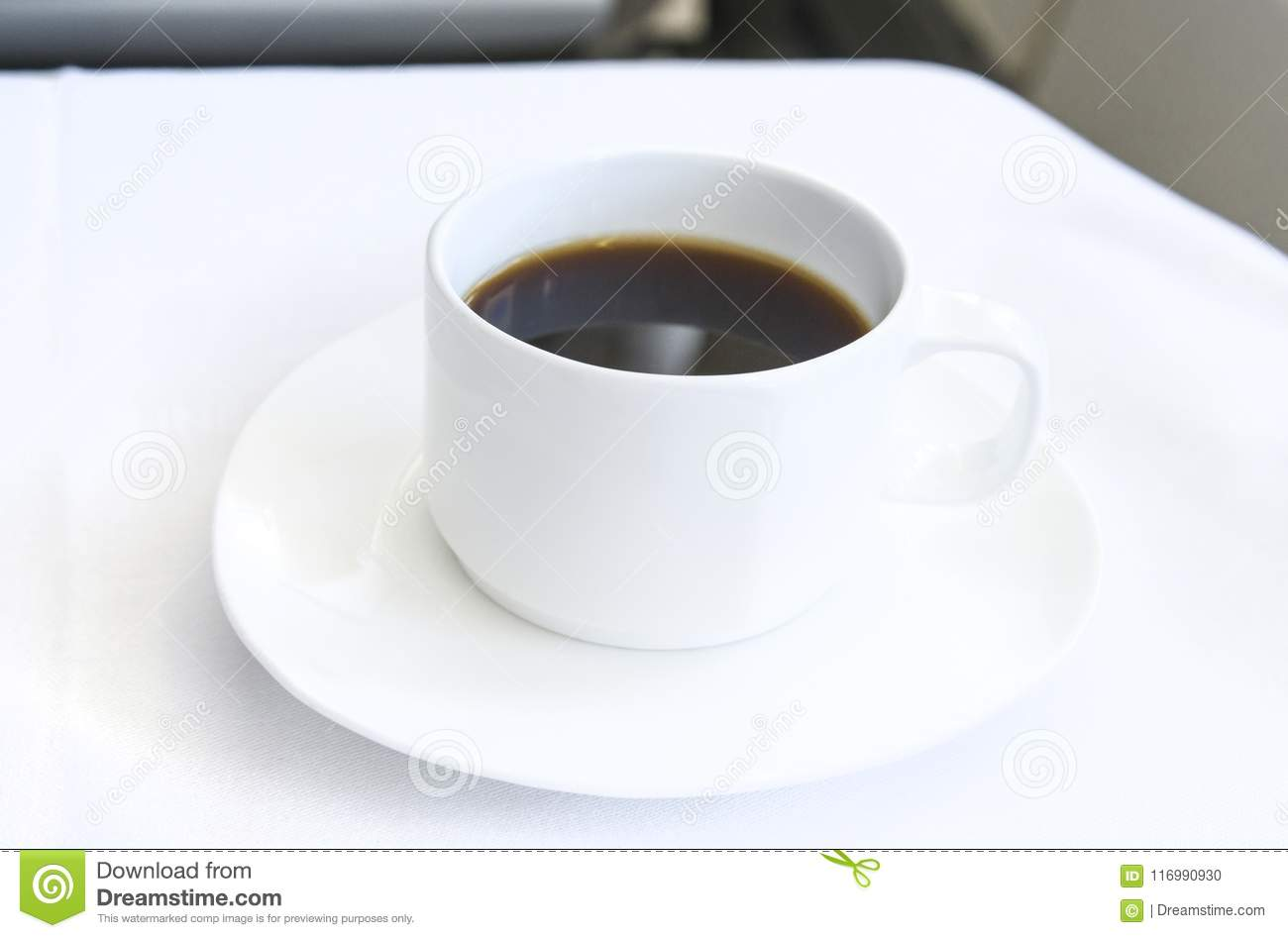 Set inflight meal appetizer coffee on a tray, on a white table