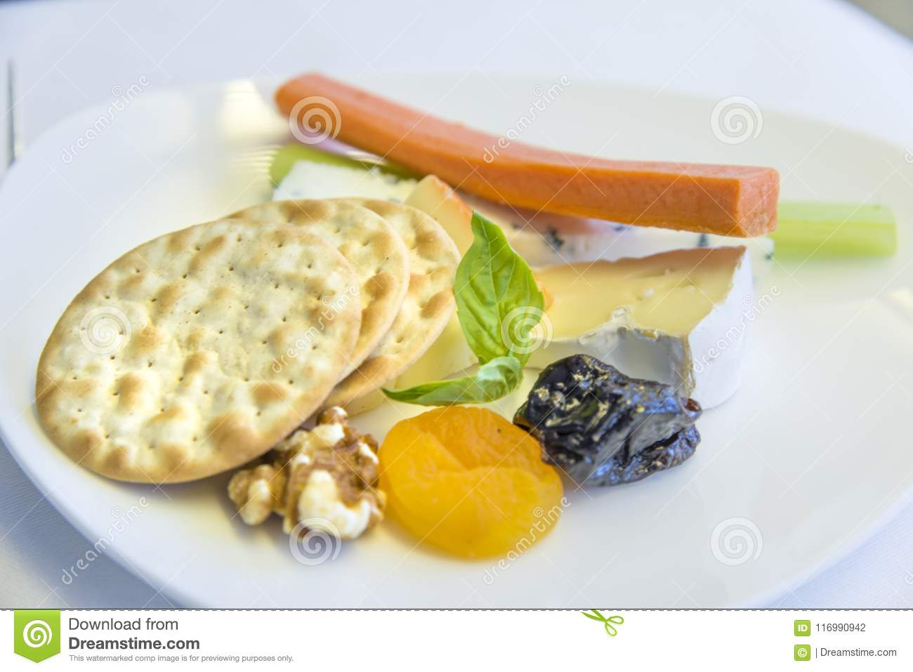 Set inflight meal appetizer on a tray, on a white table