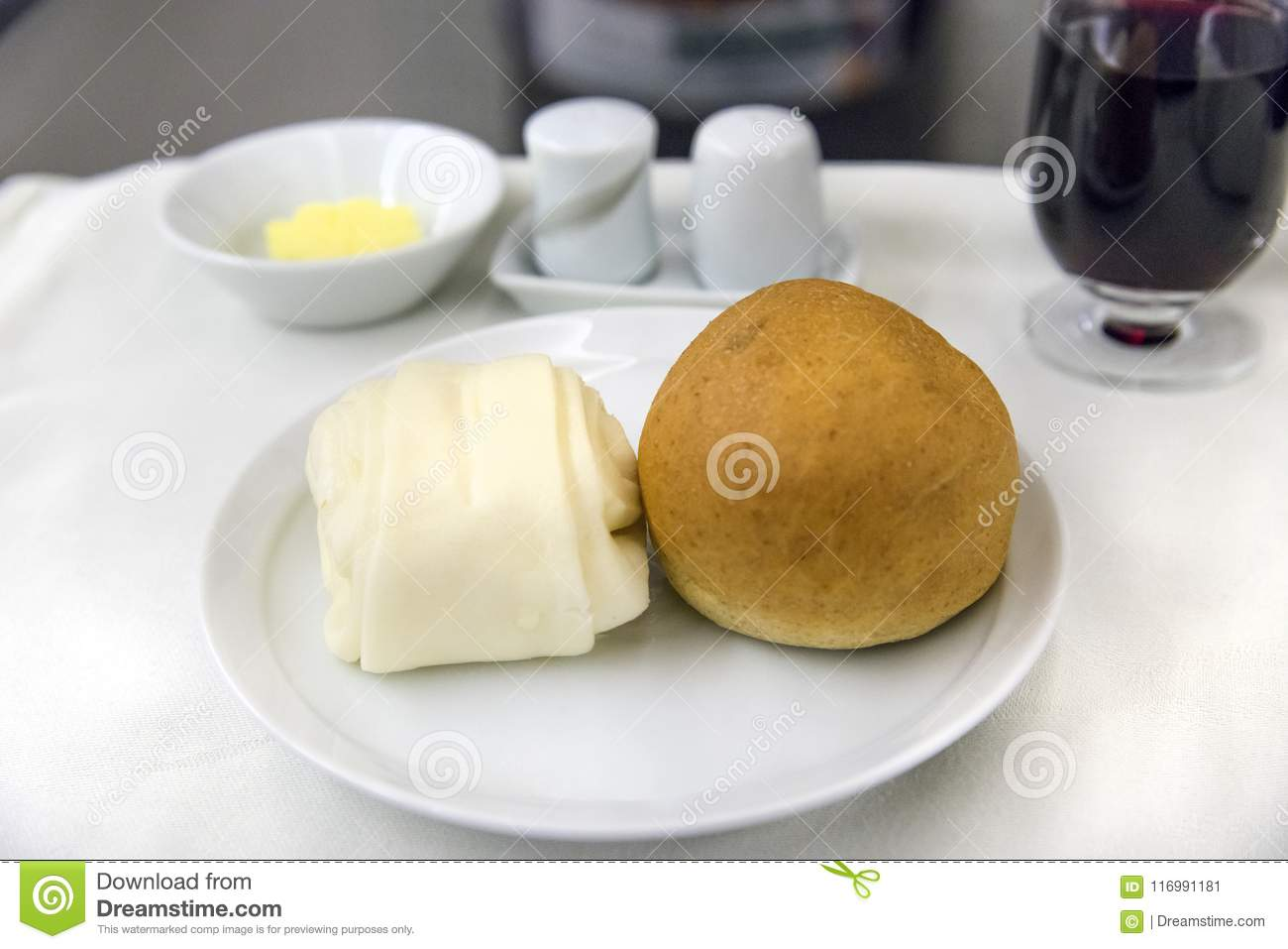 Set inflight meal on a tray, on a white table