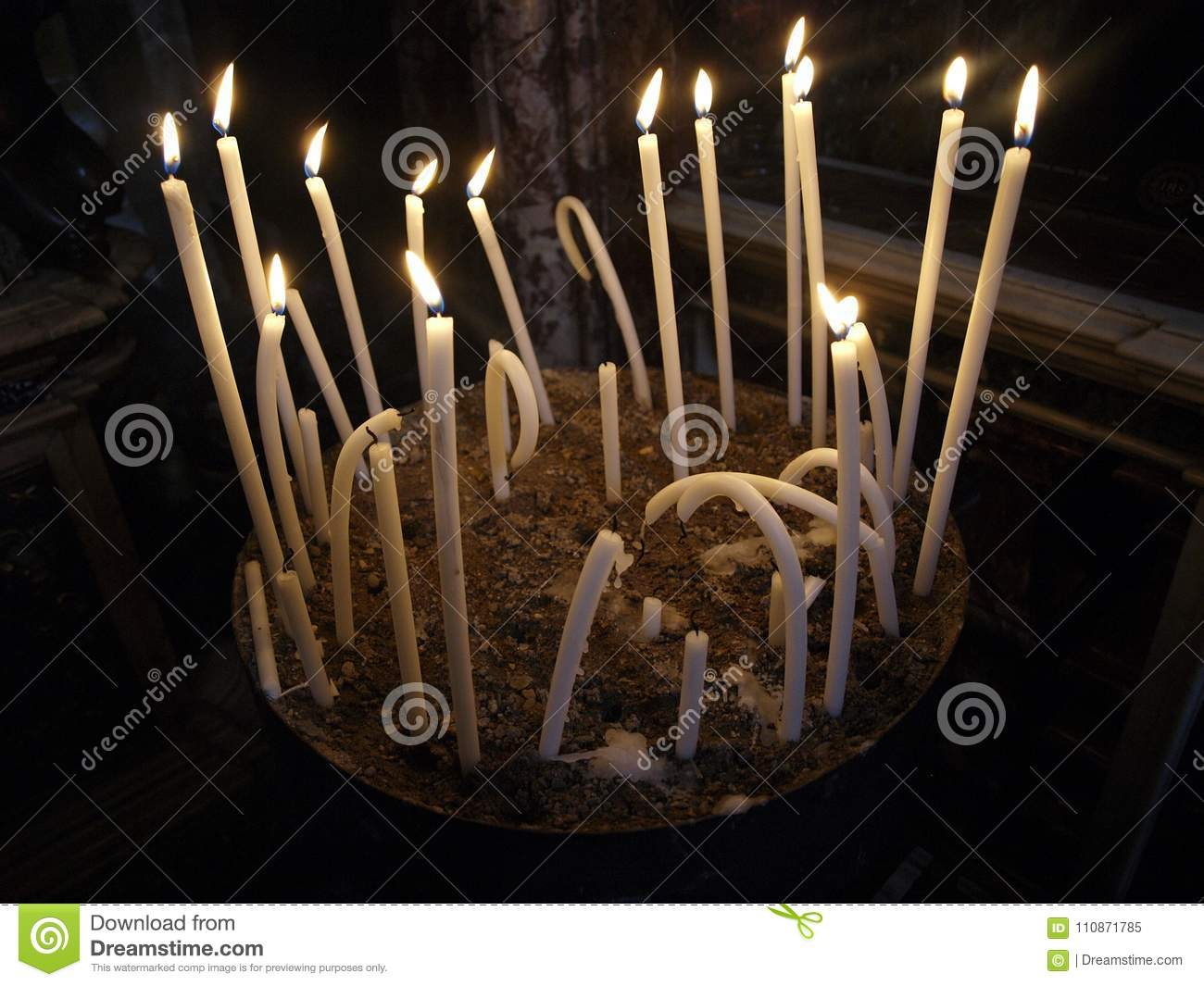 Set of long curved burning candles
