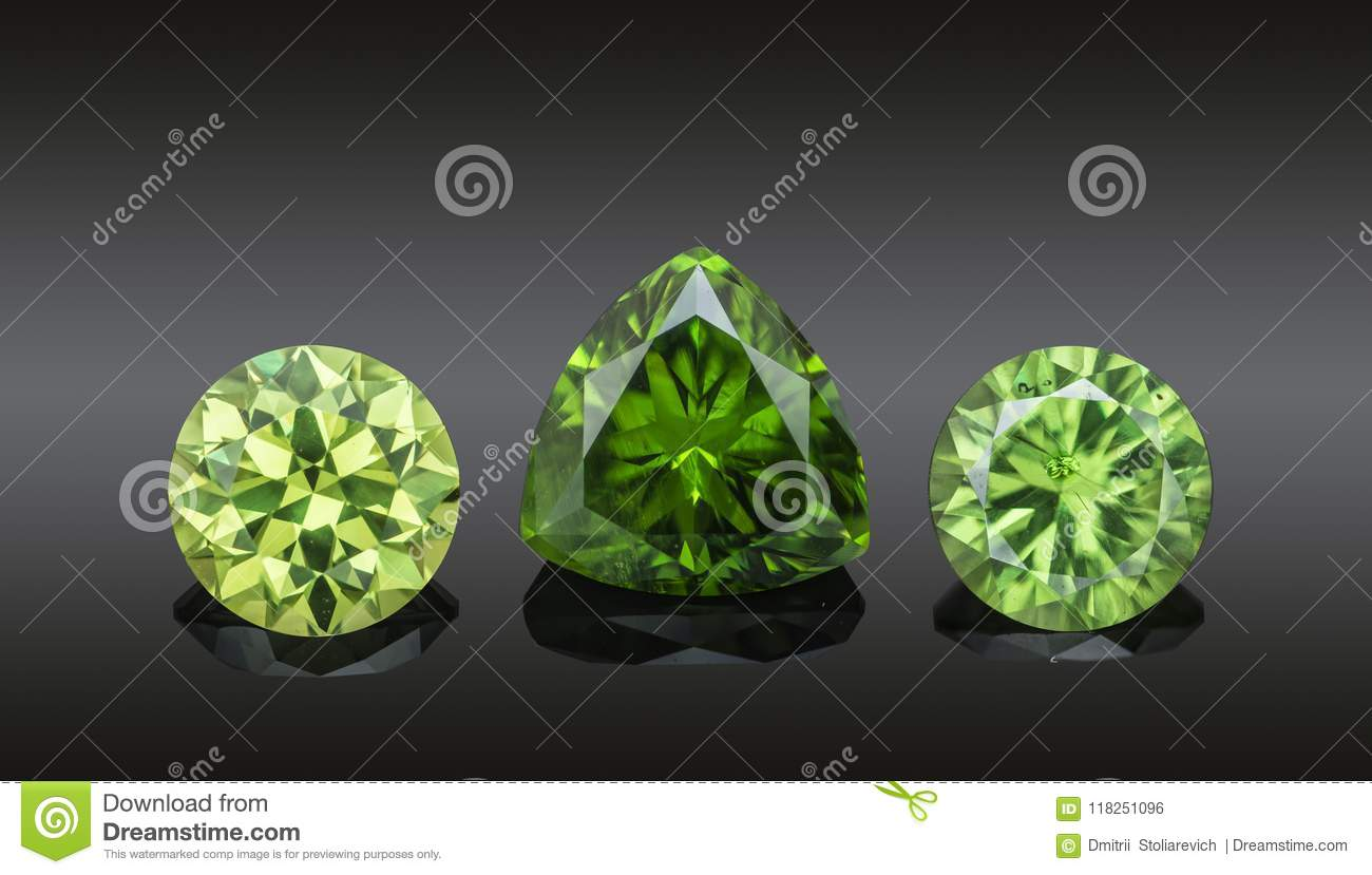Set of luxury green transparent sparkling gemstones of various cut shape demantoids collage isolated on black background