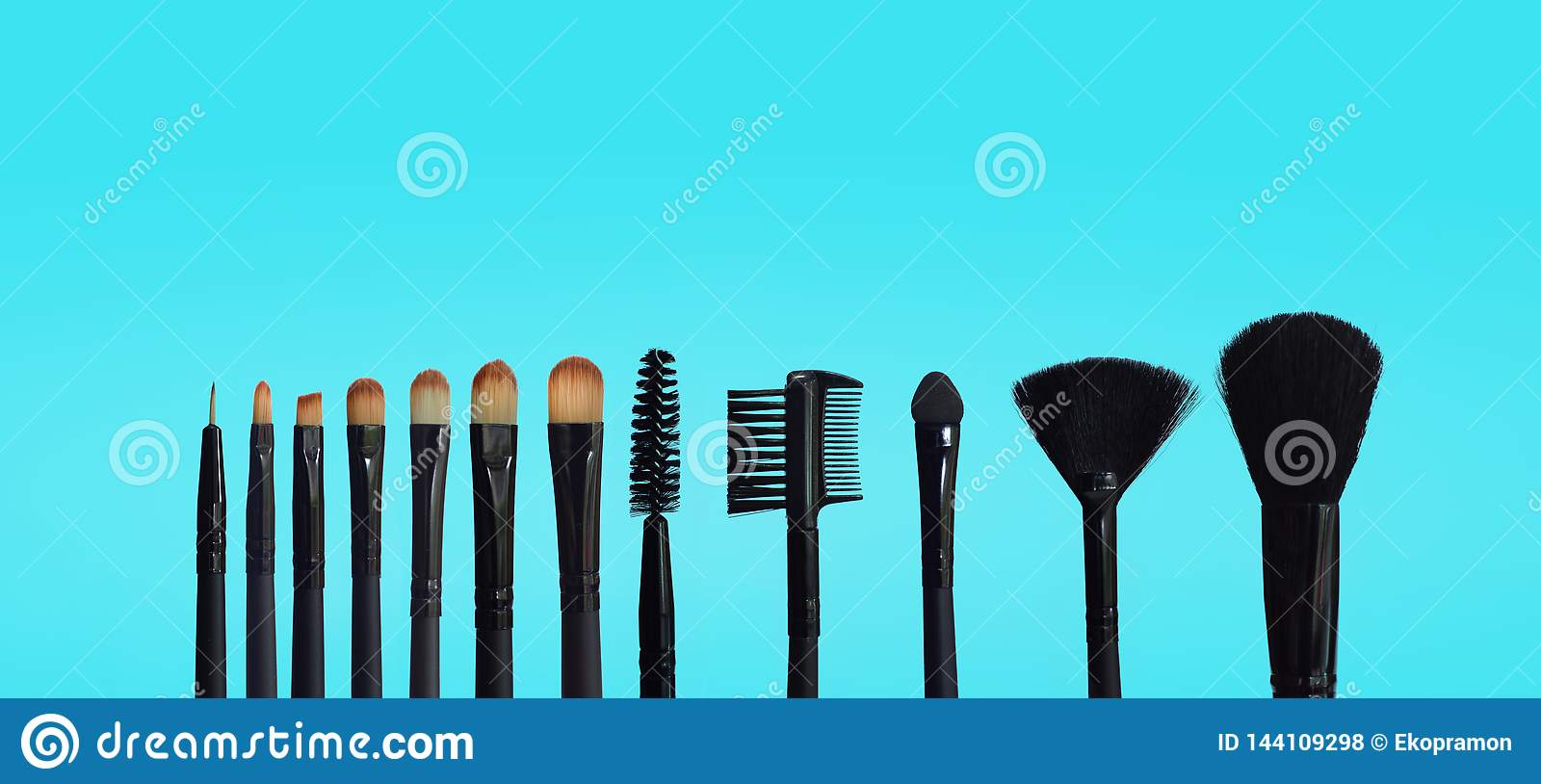 Set of makeup brushes on colored composed background