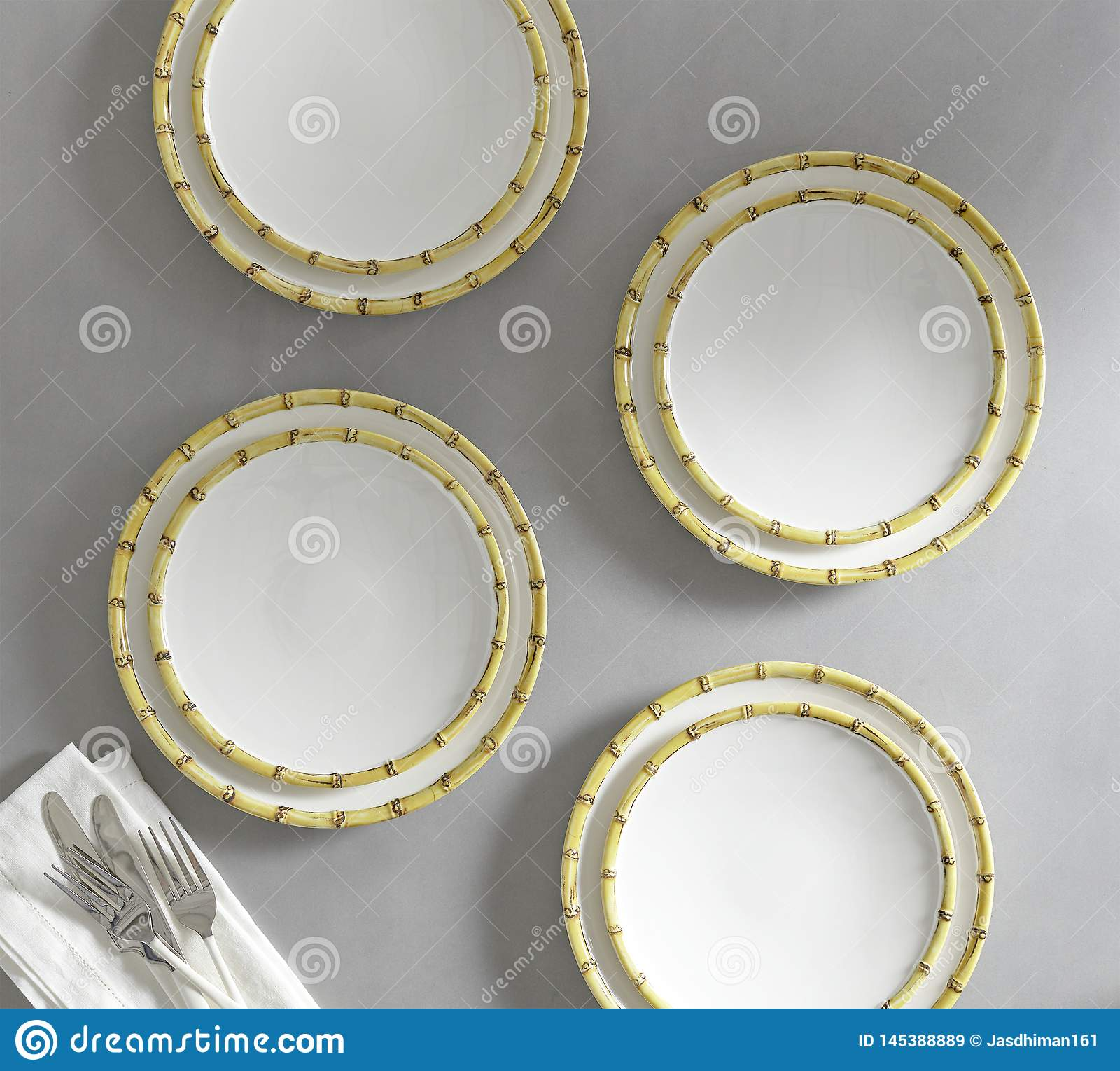 Set of 4 matching decorative plates for interior design - yellow waves.