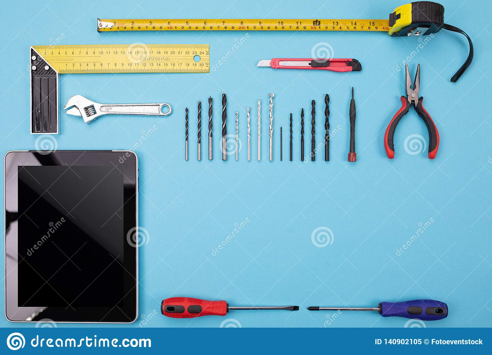 Set Of Metalwork Tools With Tablet On Colorful Background ...