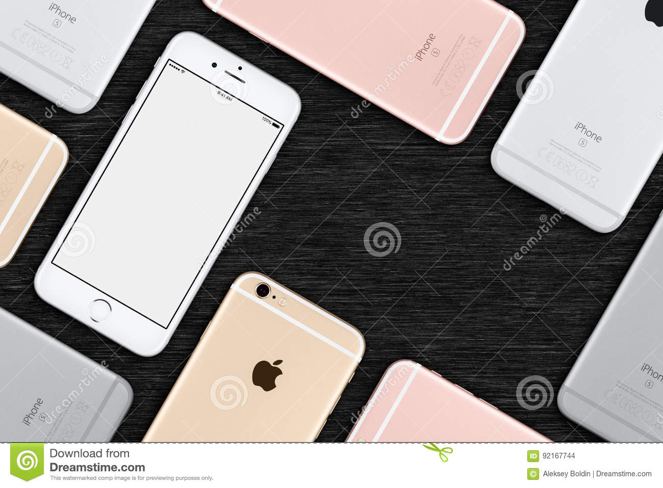 Set of multicolored Apple iPhones 6s flat lay top view lies on office desk with copy space