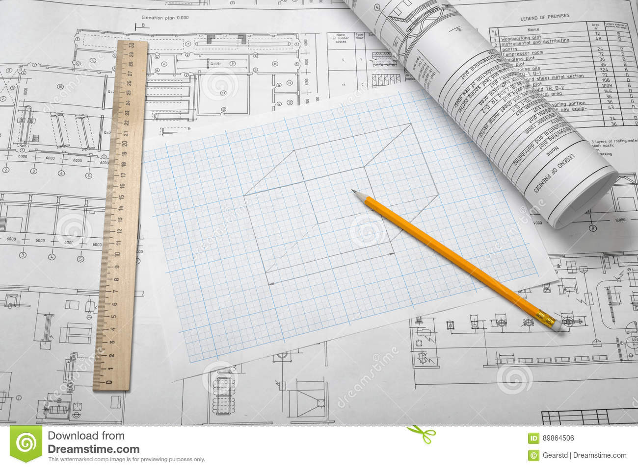 A set of open and rolled up blueprints on wooden table background download a set of open and rolled up blueprints on wooden table background with a pencil malvernweather Image collections