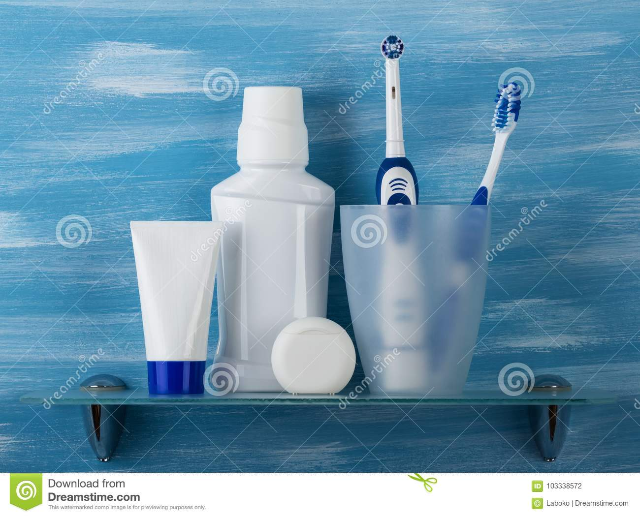 Set For Oral Care And Two Toothbrushes In A Glass Stock Photo ...