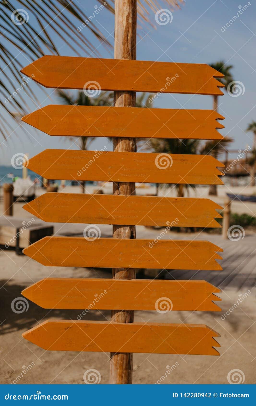 Set of orange wooden arrow pointers