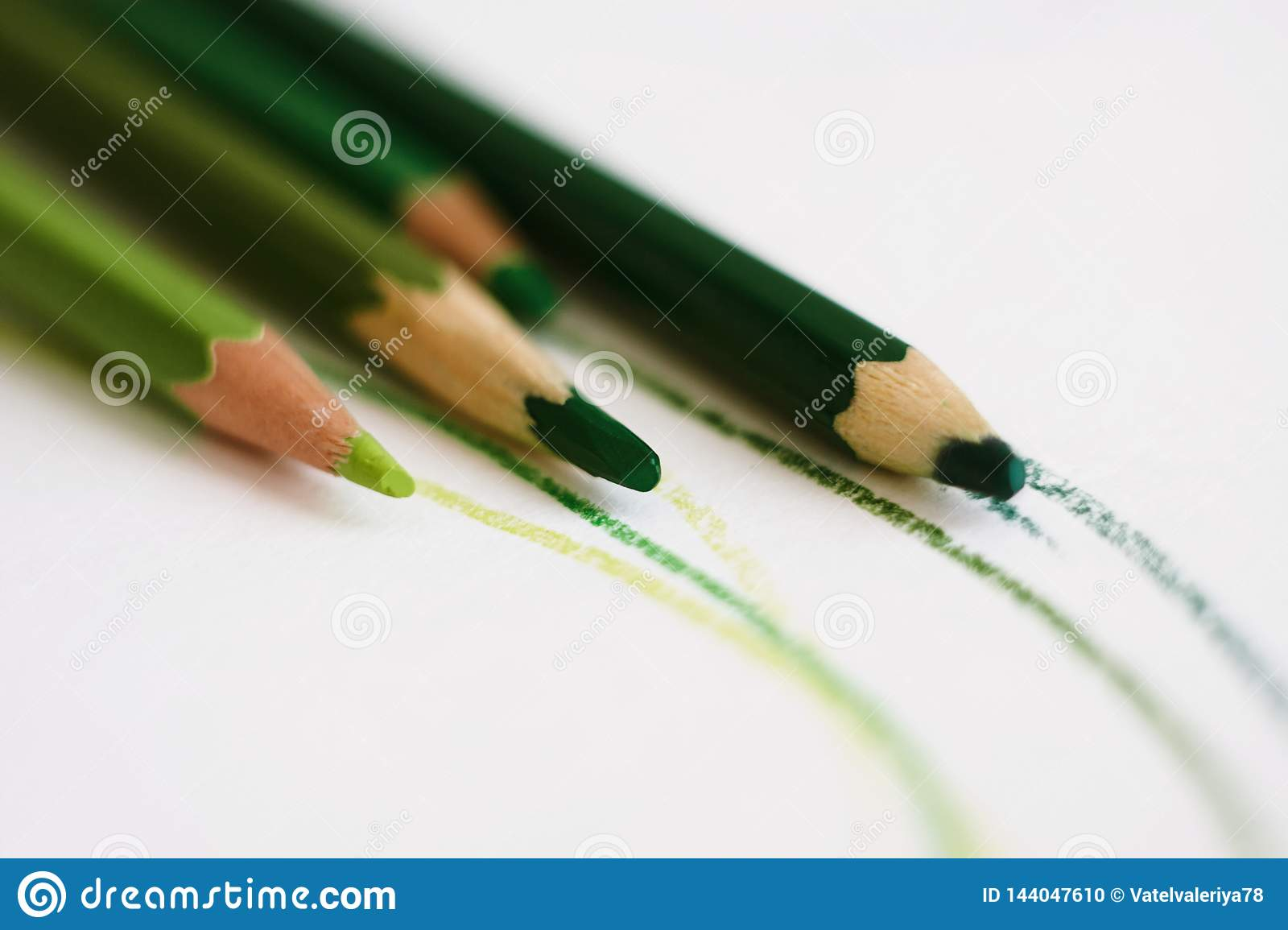 A set of pencils in different shades of green