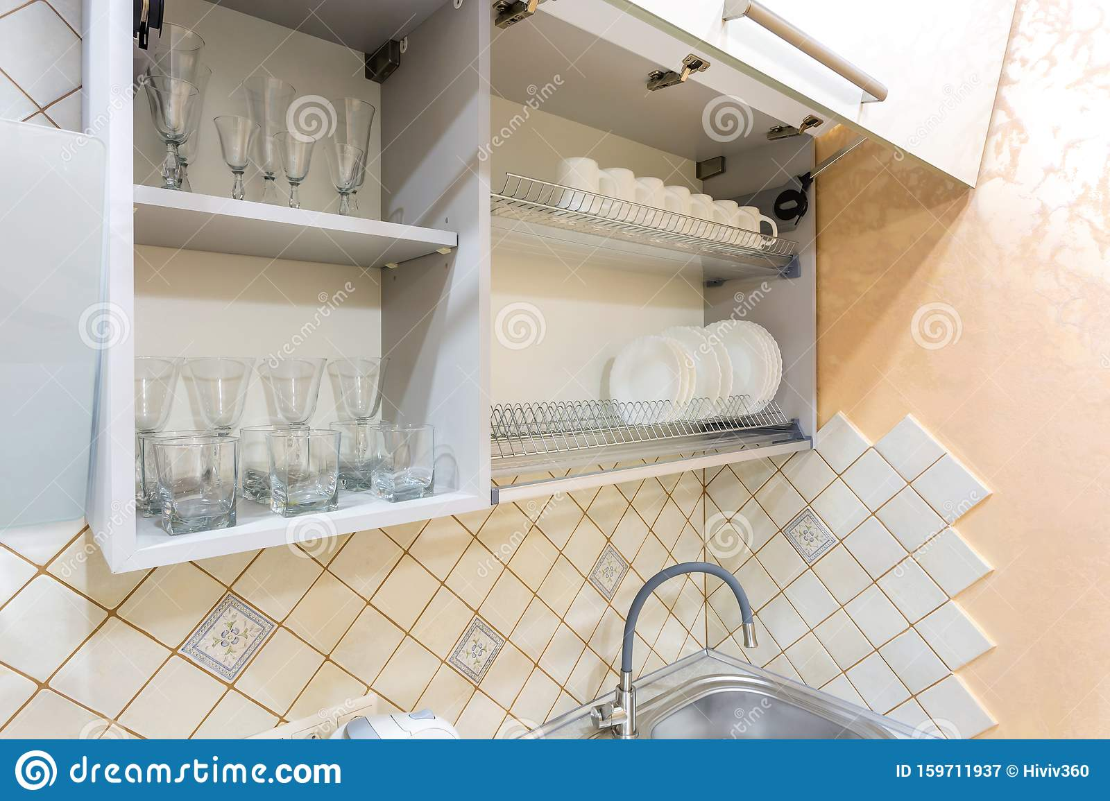 Set Of Plates, Cups And Wine Glasses On The Shelf In The ...